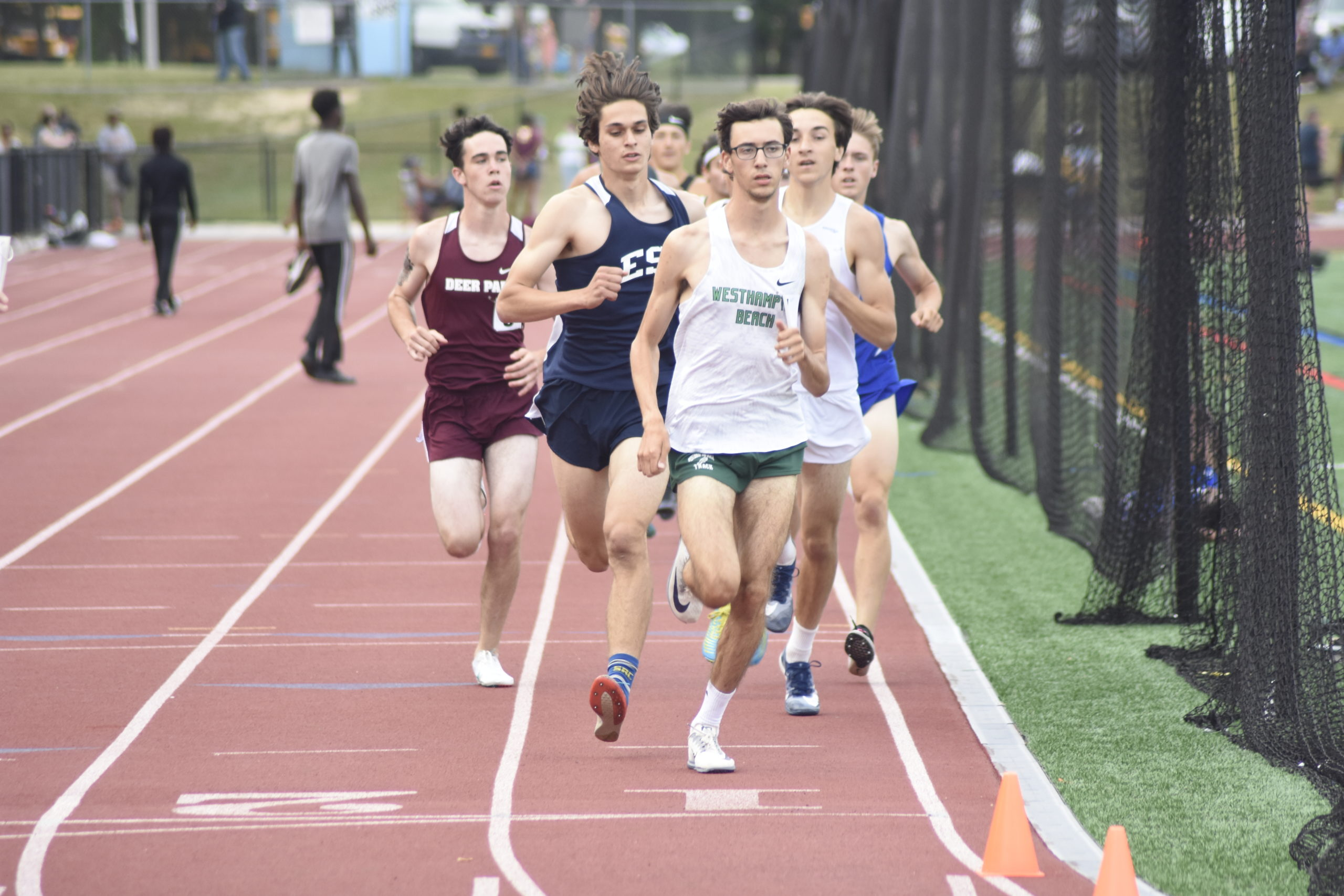Westhampton Beach junior Gavin Ehlers had to fend off Eastport-South Manor senior Michael Silveri for the county title in the 1,600-meter race on Friday.