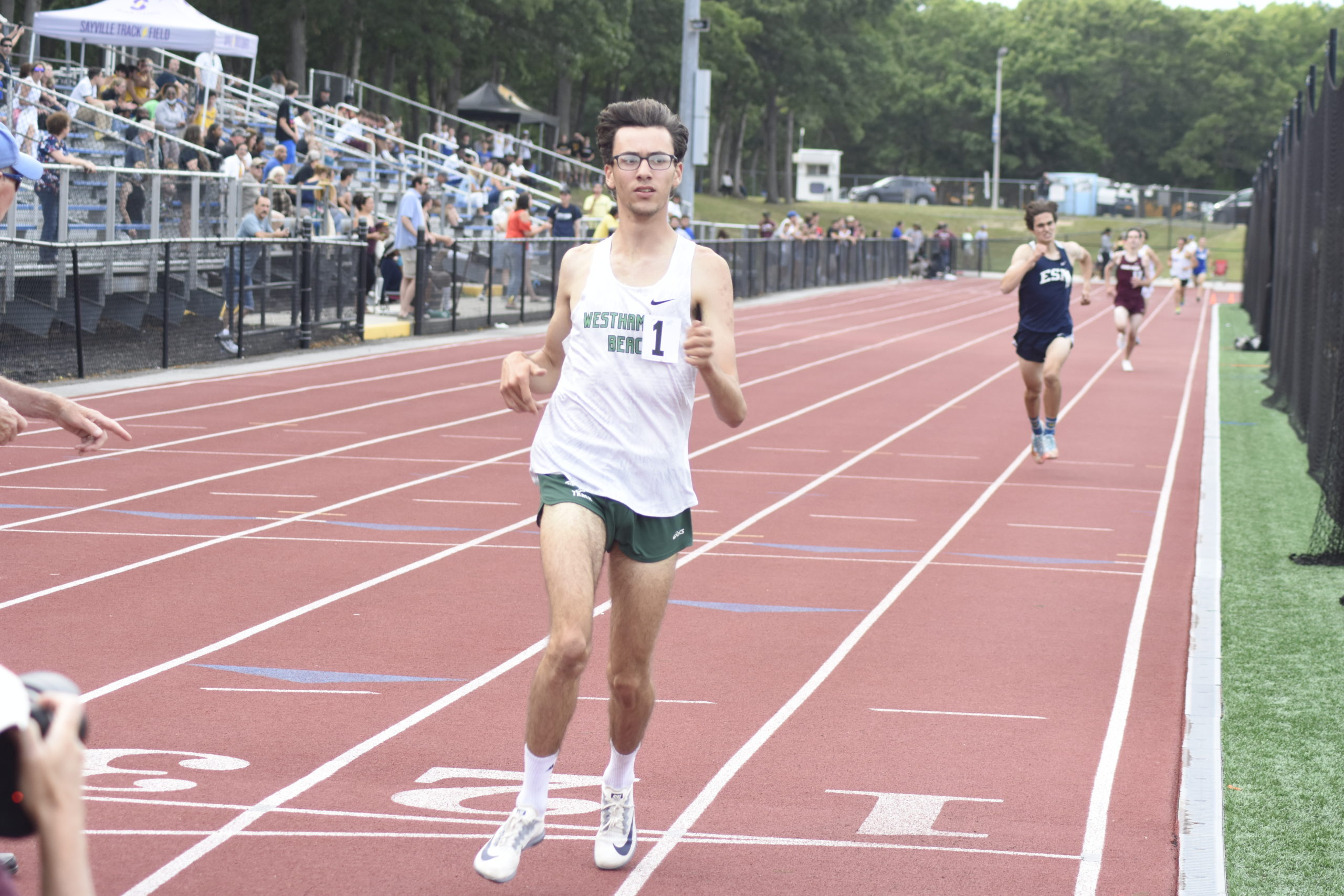 Junior Hurricane Gavin Ehlers crosses the finish line first in the 1,600-meter race to become county champion.