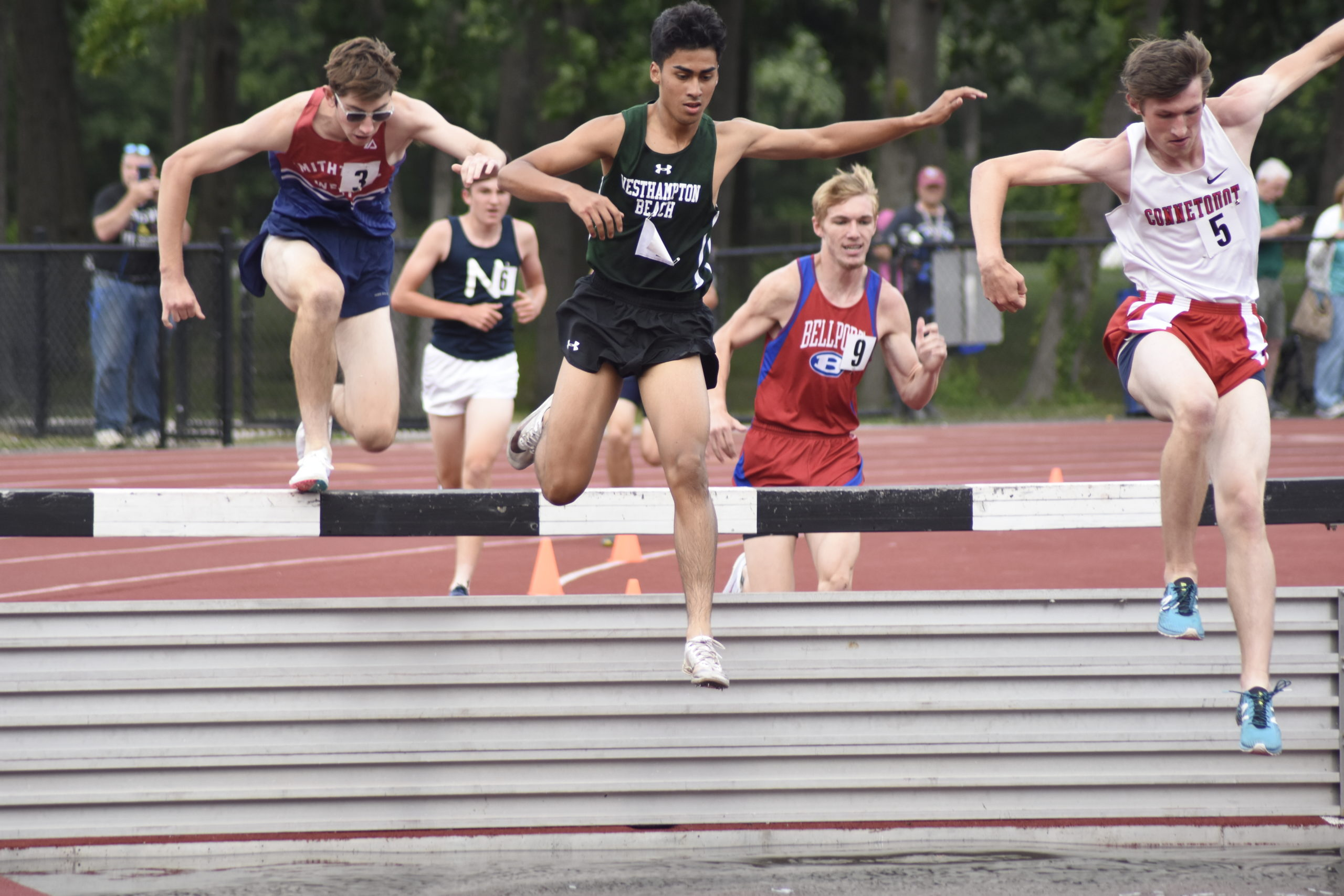 Westhampton Beach junior David Alvarado gets set to make his way into the water pit of the 3,000-meter steeplechase.