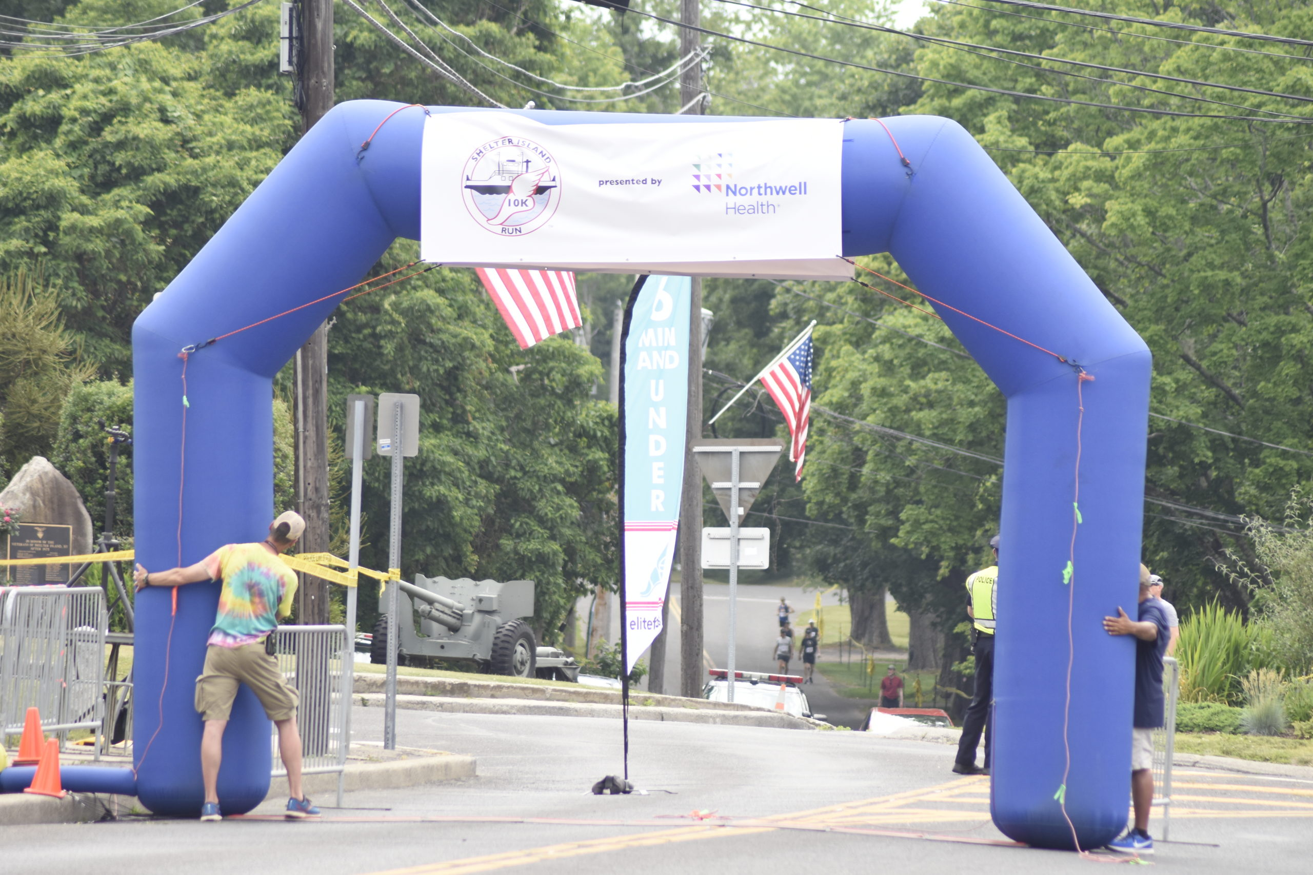 Race officials start to put up the official gate of the Shelter Island 10K just prior to the start of the race.