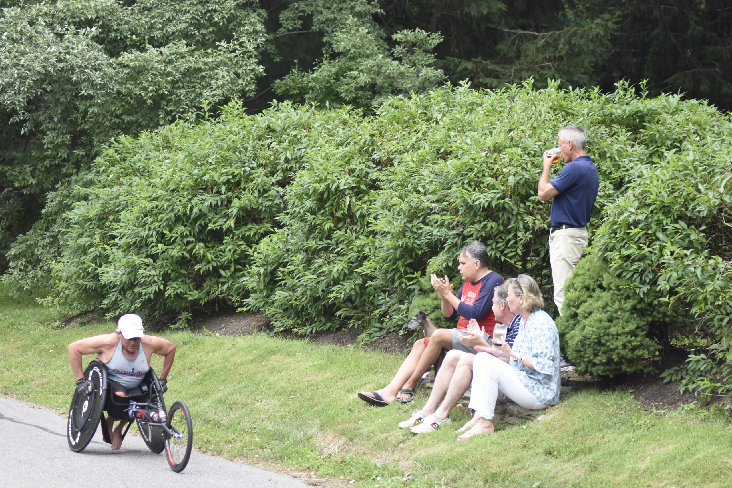 Spectators cheer on William Lehr as he passes by.