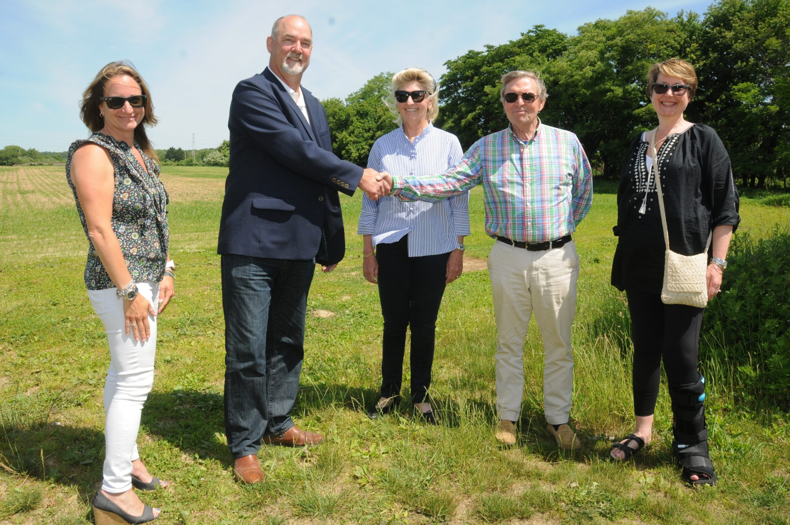 Britton Bistrian, left, Supervisor Peter Van Scoyoc, Barbara Bistrian, Barry Bistrian and Councilwoman Kathee Burke-Gonzalez at the Bistrian family farm in Amagansett that the town has agreed to purchase for $28 million.    RICHARD LEWIN