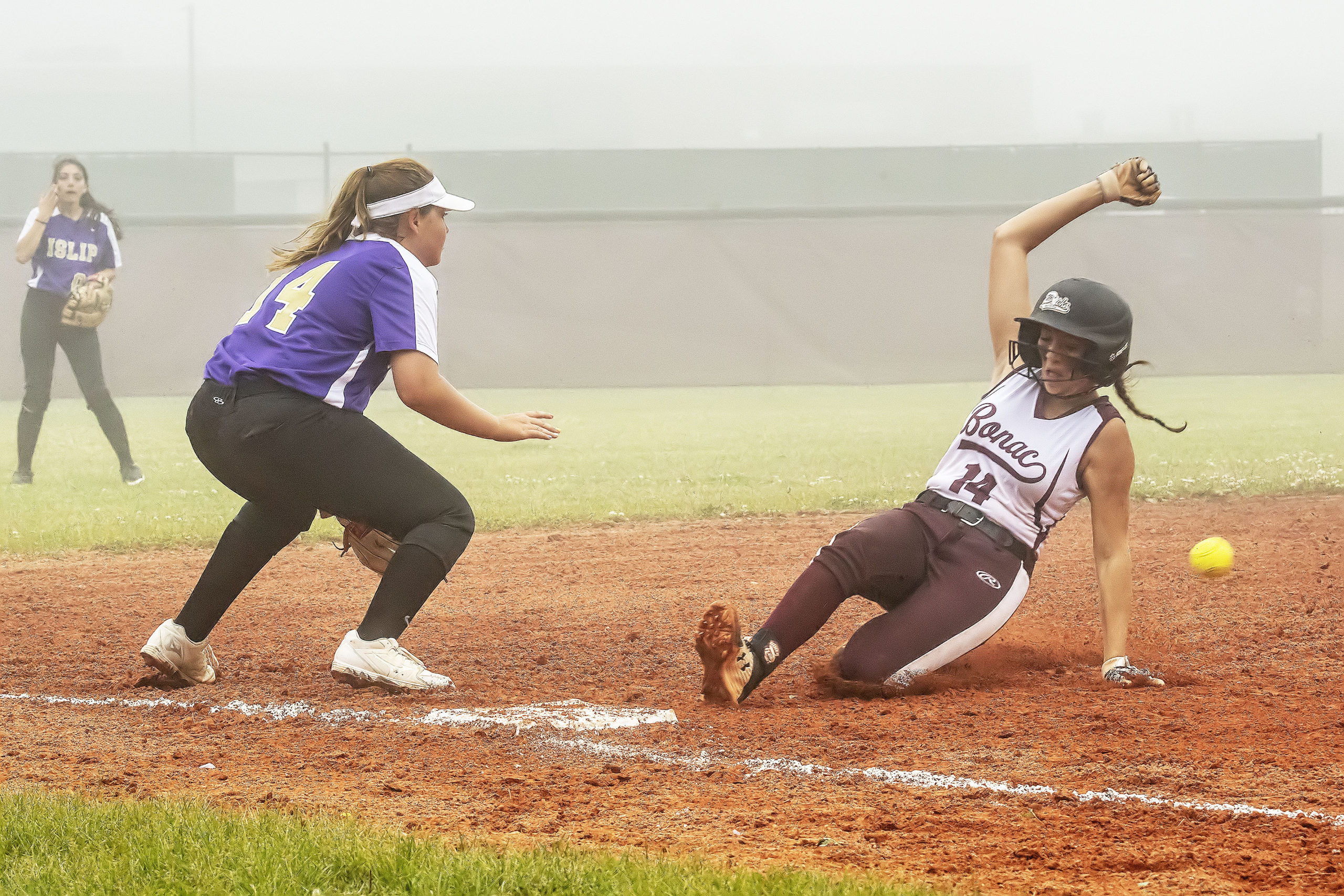 East Hampton sophomore Emma Terry is safe at third.