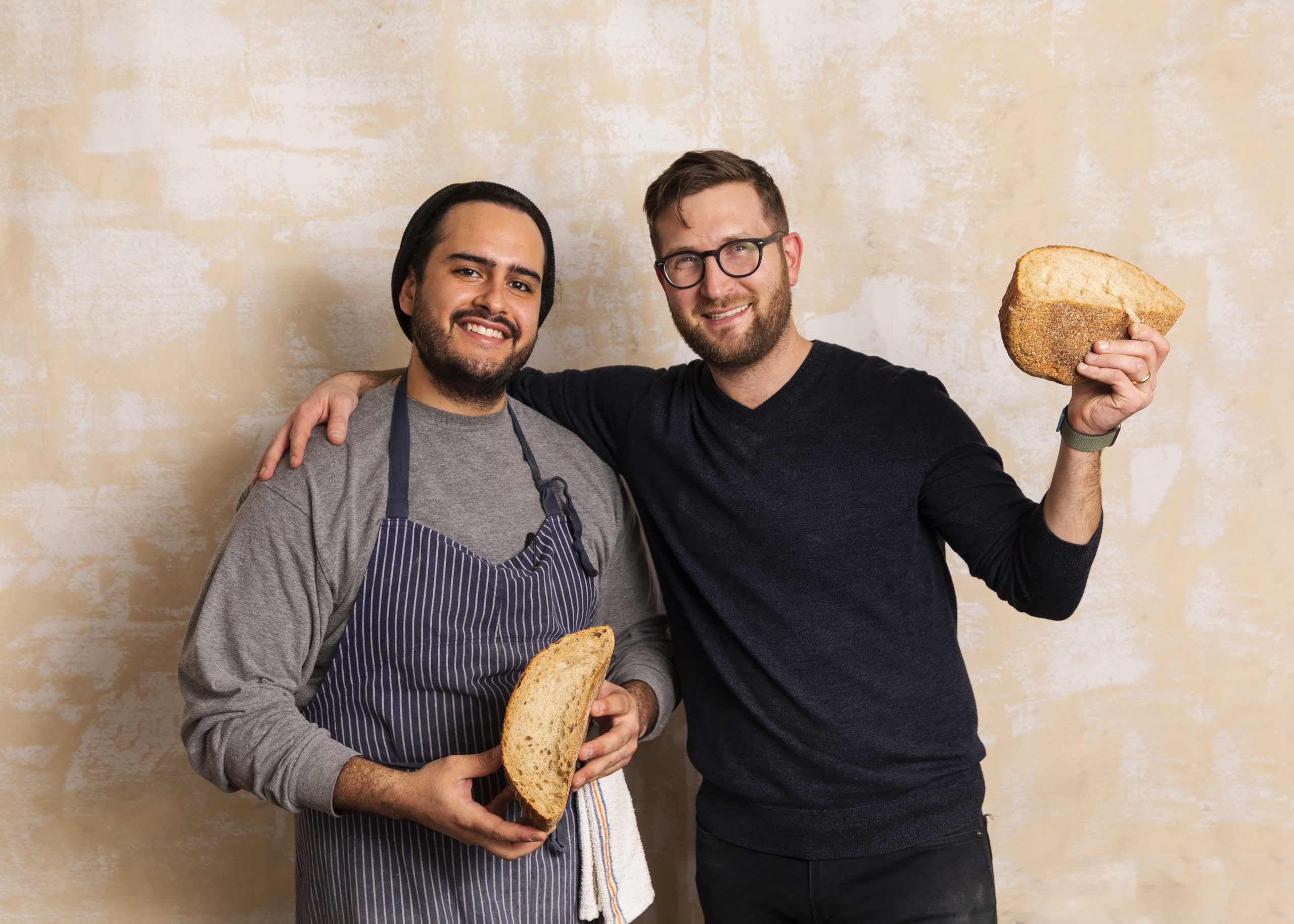 Head baker Carlos Barbosa and founder and CEO Stephen Robinson with some of their famous bread.
