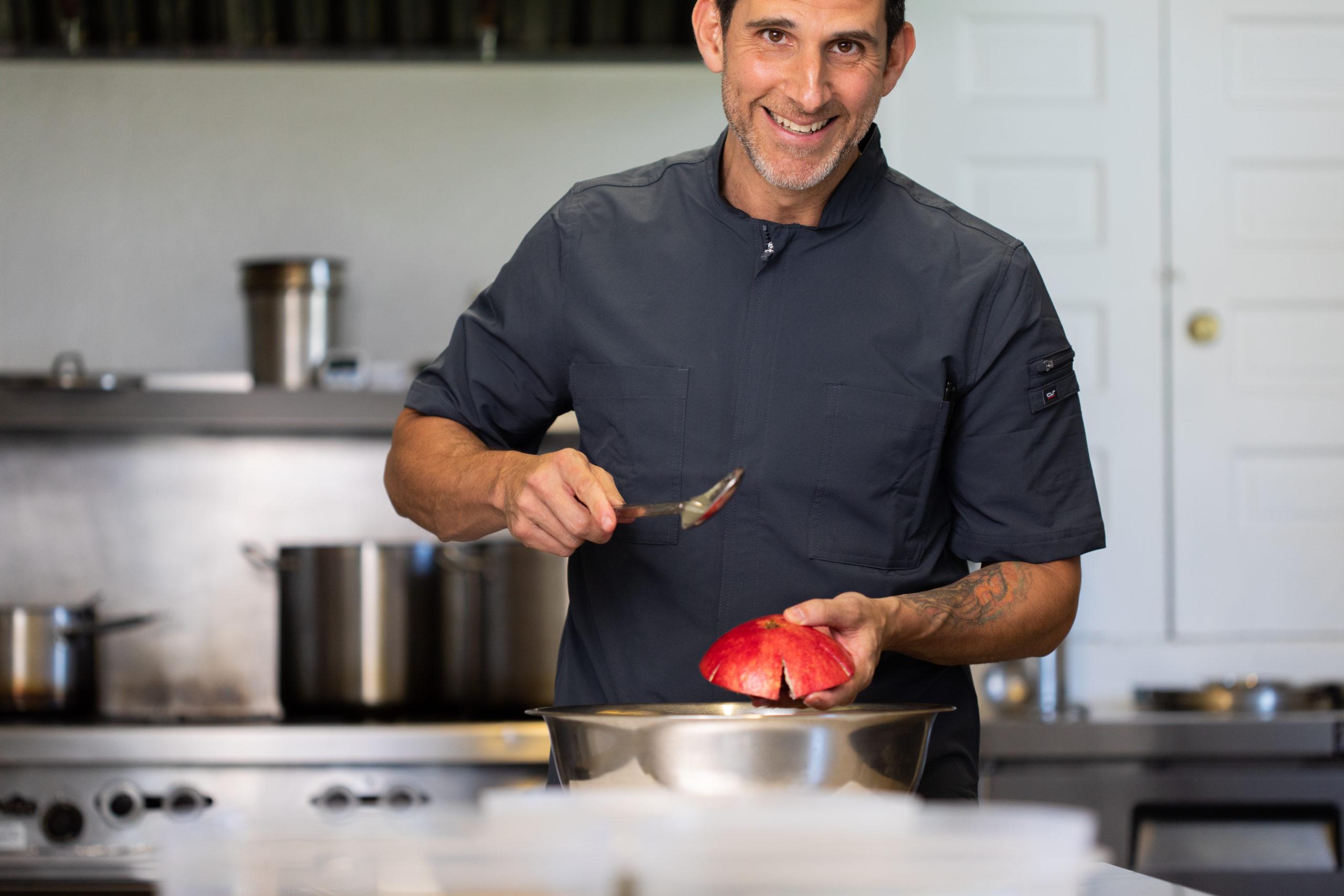 Corey De Rosa cooking in the kitchen.