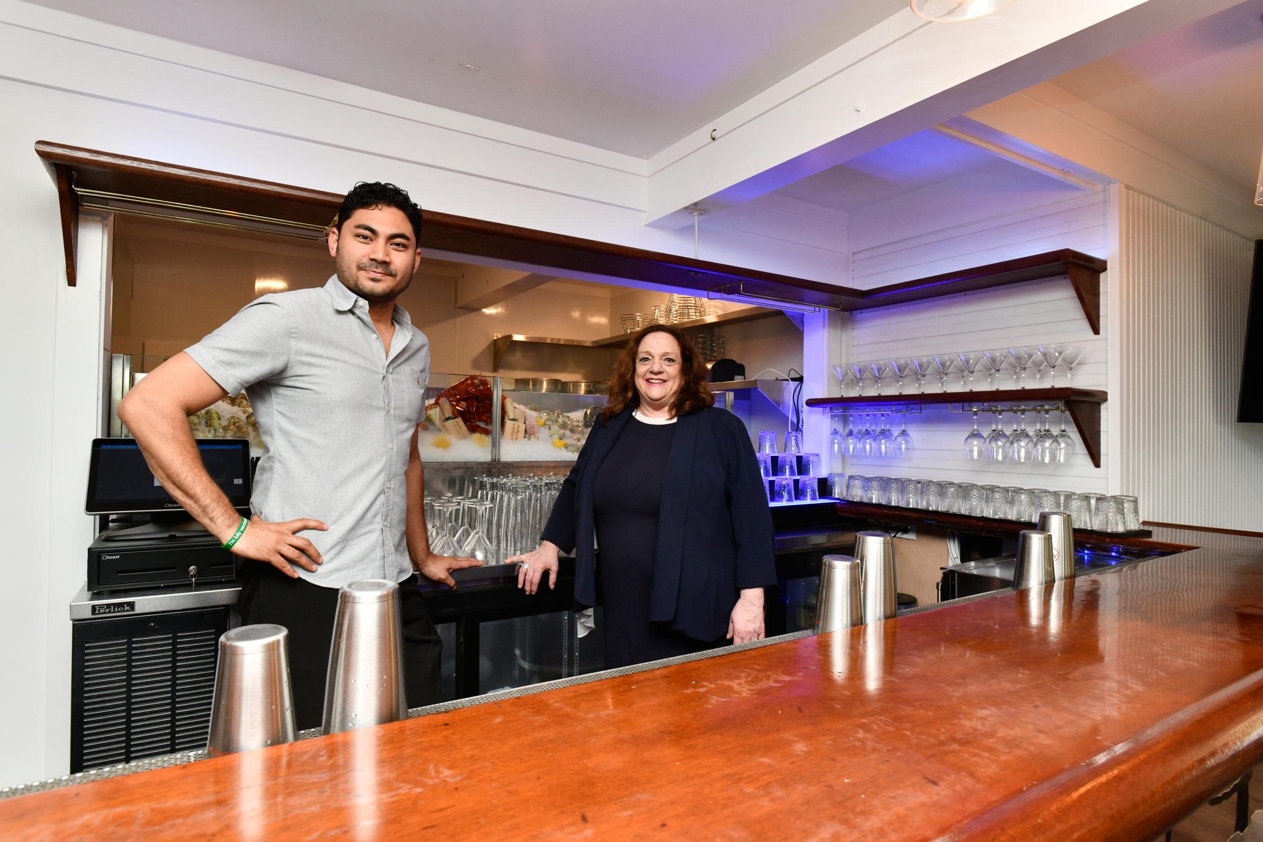 Jesse Matsuoka and Donna Lanzetta behind the bar at Manna.  DANA SHAW