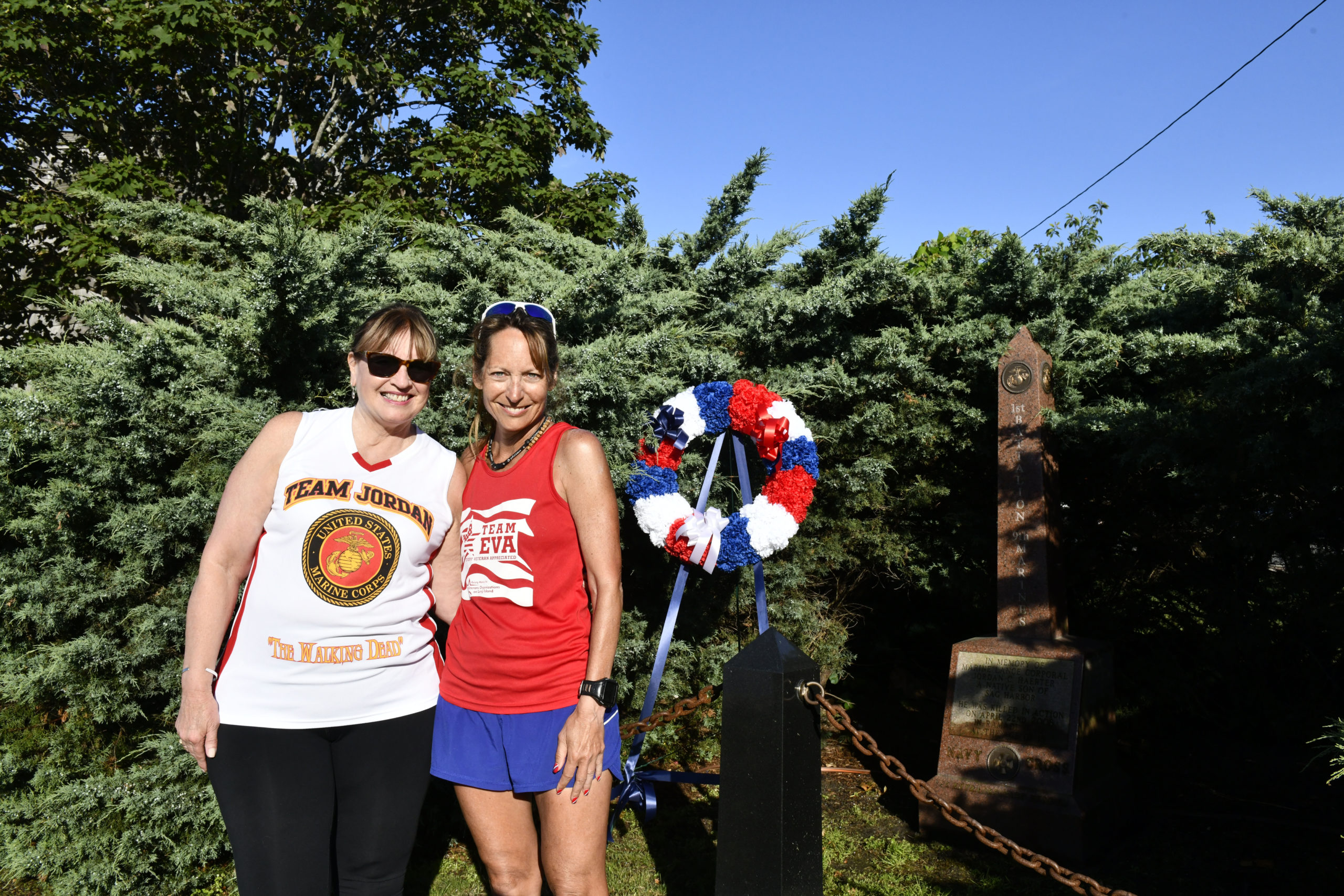 Ultra-Marathon Runner Eva Casale, right, with JoAnn Lyles, mother of fallen Marine Jordan Haerter, at the Jordan Haerter Memorial in Sag Harbor on Thursday. For past five years, Ms. Casale  has used her talent to run long distances and capitalizing on her physical and mental focus by pounding the pavement a minimum of 26.2 miles each day to raise funds to honor troops, local veterans and those who have fallen.  Ms. Casale ended her run at the Westhampton VFW Post 5350 on Saturday evening.             DANA SHAW