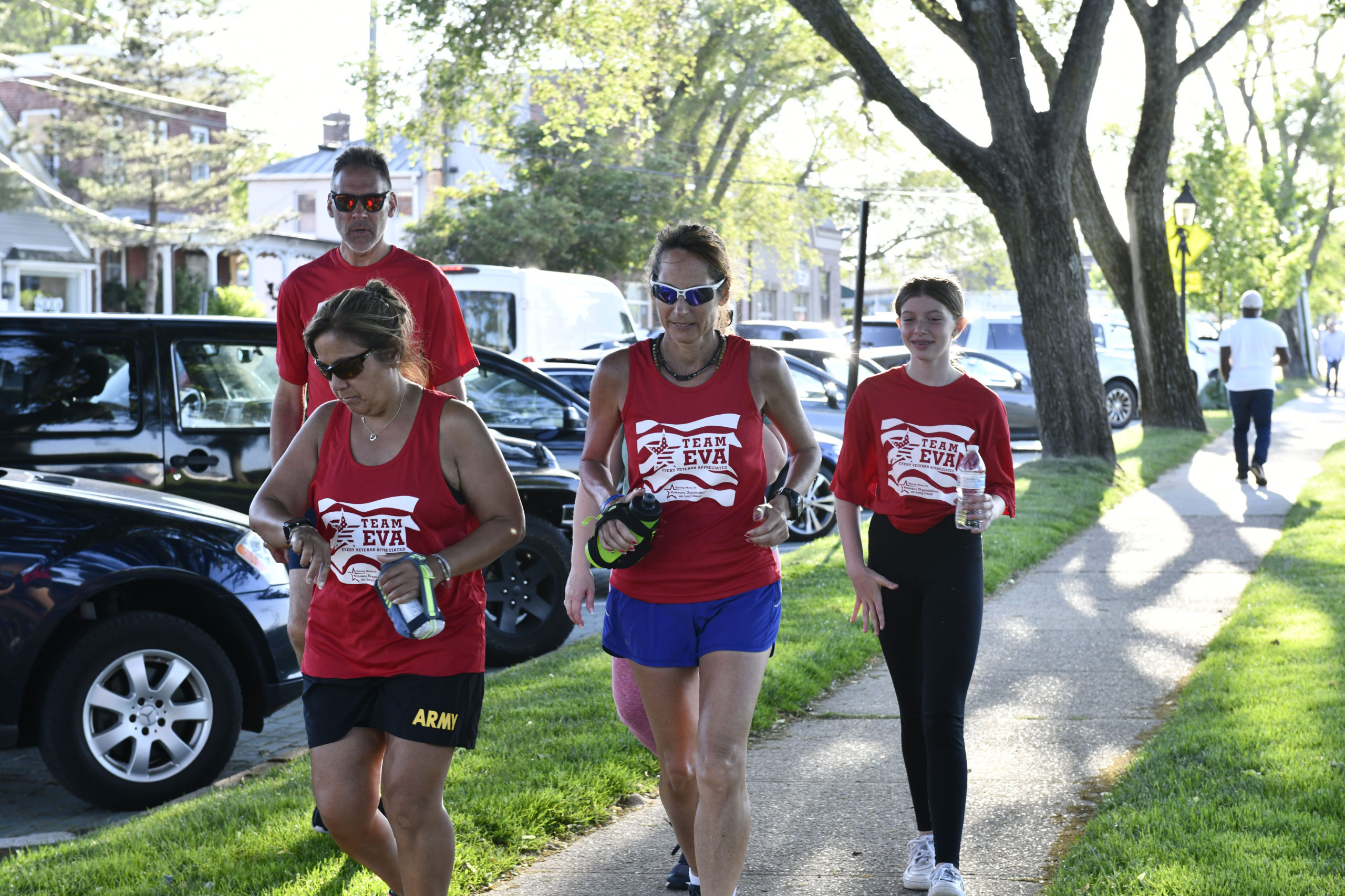 Ultra-Marathon Runner Eva Casale, center, in Sag Harbor on Thursday. For past five years, Ms. Casale  has been using her talent to run long distances and capitalizing on her physical and mental focus by pounding the pavement a minimum of 26.2 miles each day for seven day to raise funds to honor  troops,  local veterans and those who have fallen.  Ms. Casale ended her run at the Westhampton VFW Post 5350 on Saturday evening. DANA SHAW