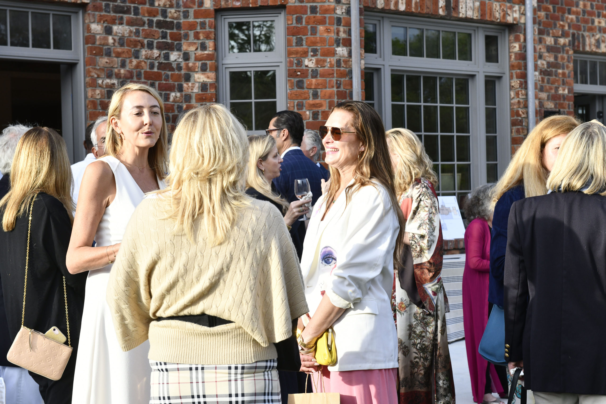 Local and celebrity guests, like, Brooke Shields, left, at the event at the newly restored Grosvenor Atterbury Estate in Southampton Village on June 12.  DANA SHAW