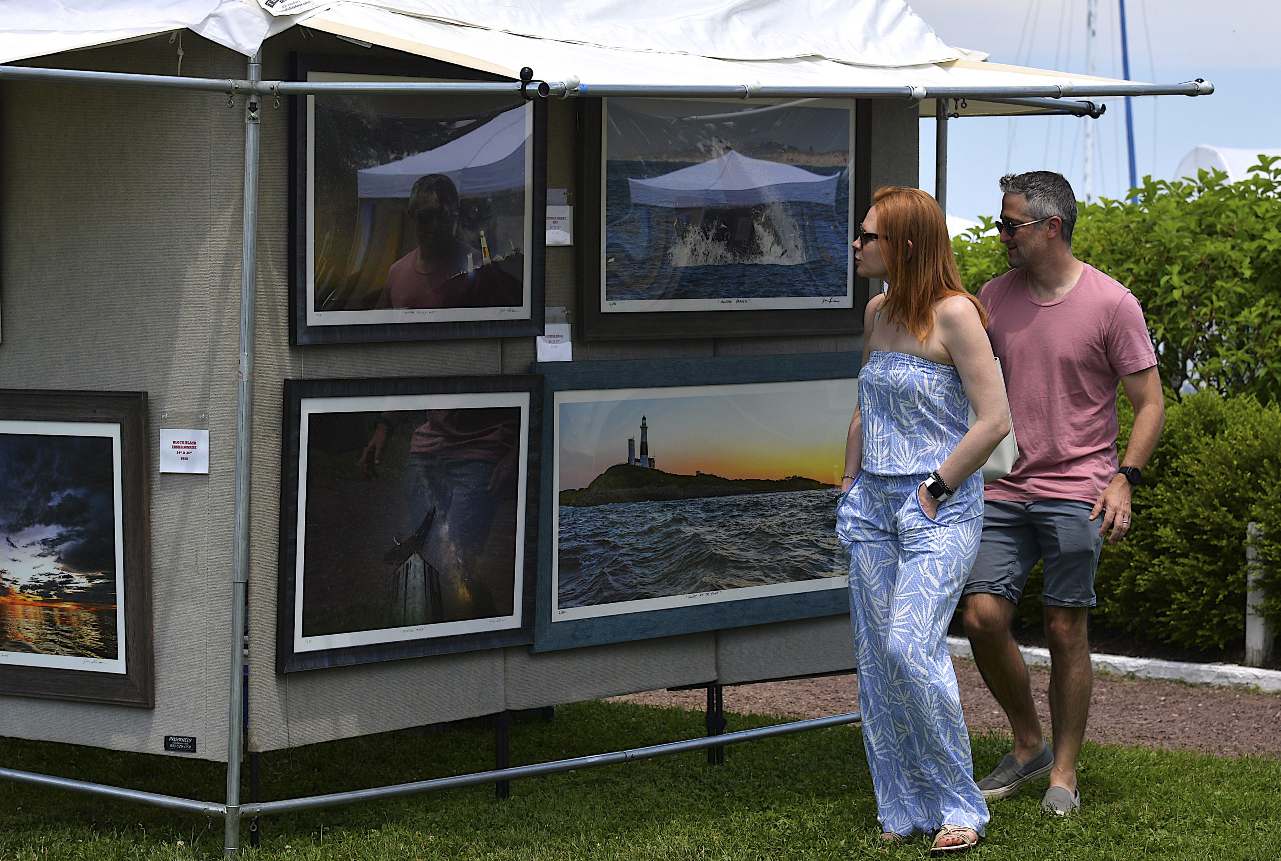 Visitors browse at the Sag Harbor Arts and Crafts Fair in Marine Park on Saturday.     KYRIL BROMLEY