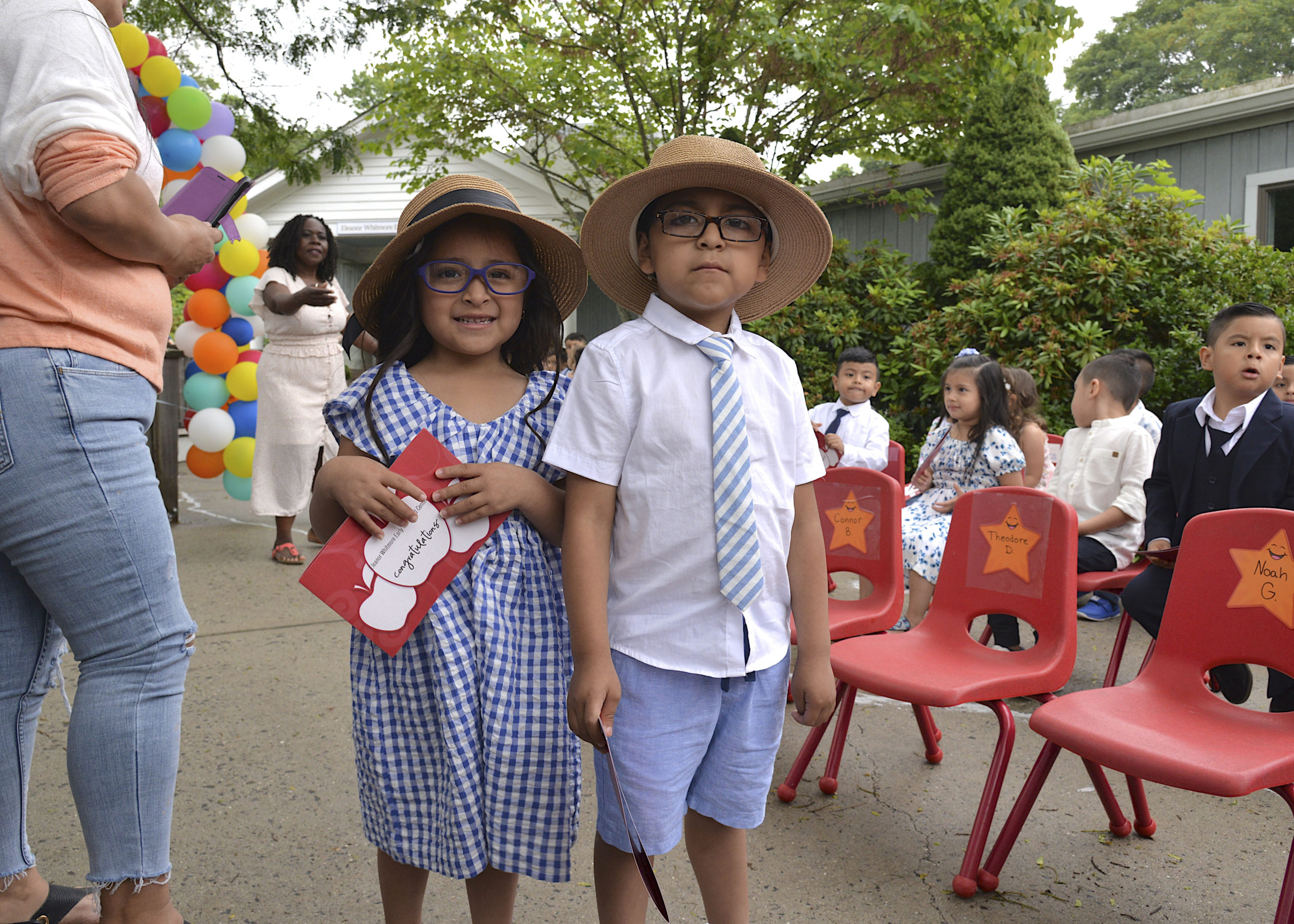 Valeria and Axel Yaguarem at the Eleanor Whitmore Early Childhood Center's  Pre-K moving up ceremony on Friday for the more than 40 children who will celebrate their official entry into Kindergarten.   KYRIL BROIMLEY