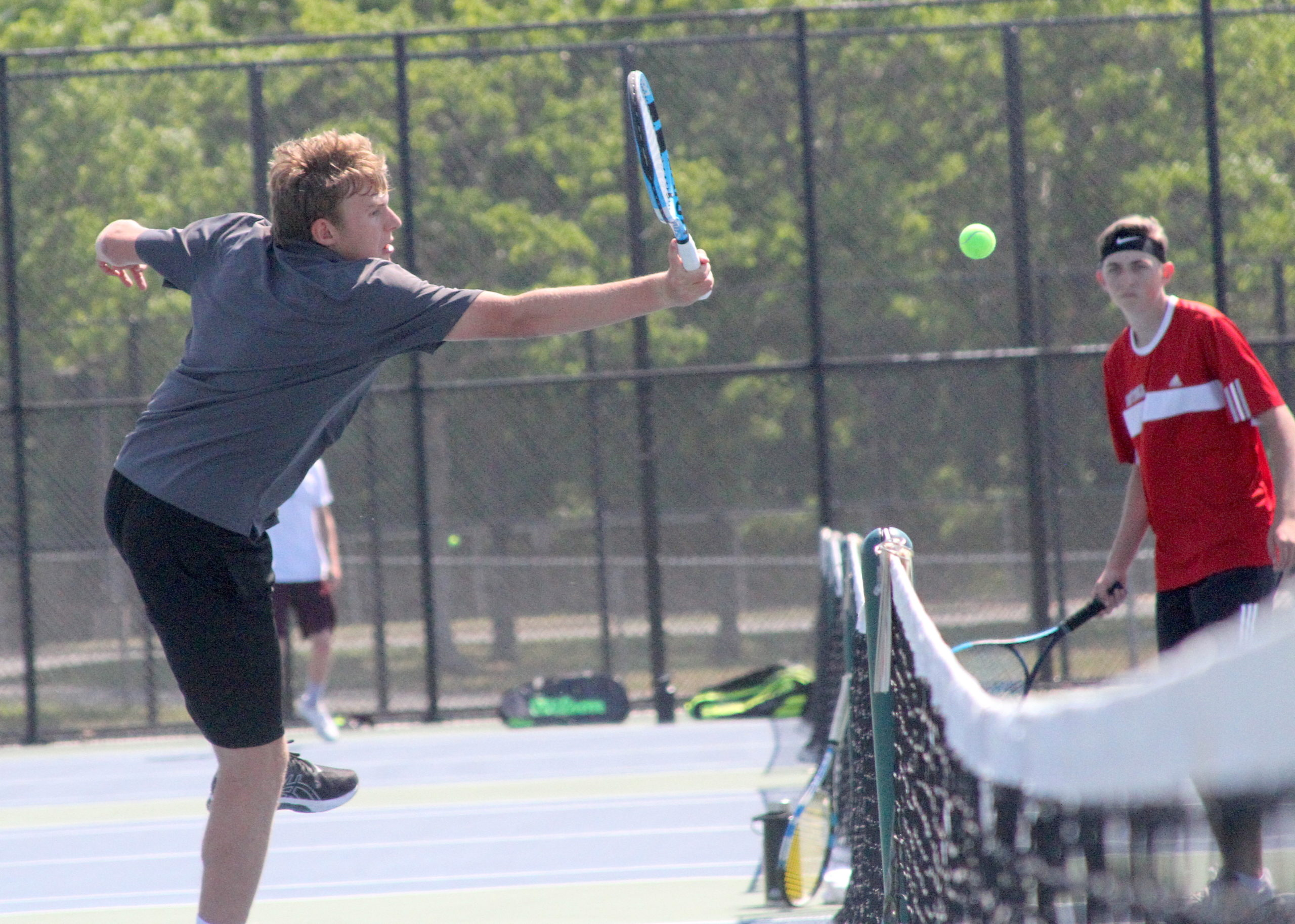 East Hampton senior RJ Jones volleys at the net for the Bonackers in the quarterfinals of the Division IV doubles tournament. DESIRÉE KEEGAN