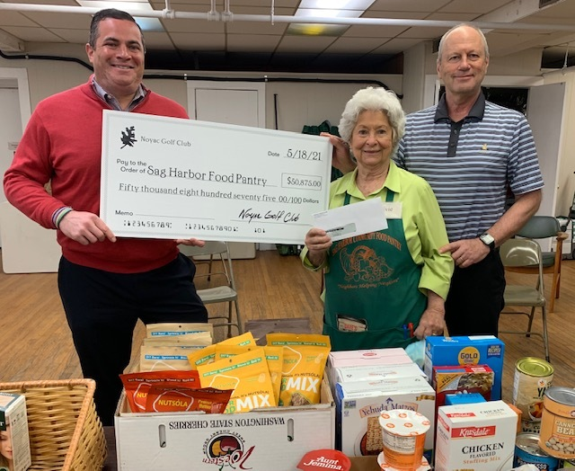 Jesse Smith, Noyac Golf Club General Manager and Steve Maietta, Noyac Golf Club Board Member, present a check for $50,875 to Sag Harbor Food Pantry Director Evelyn Ramunno.
