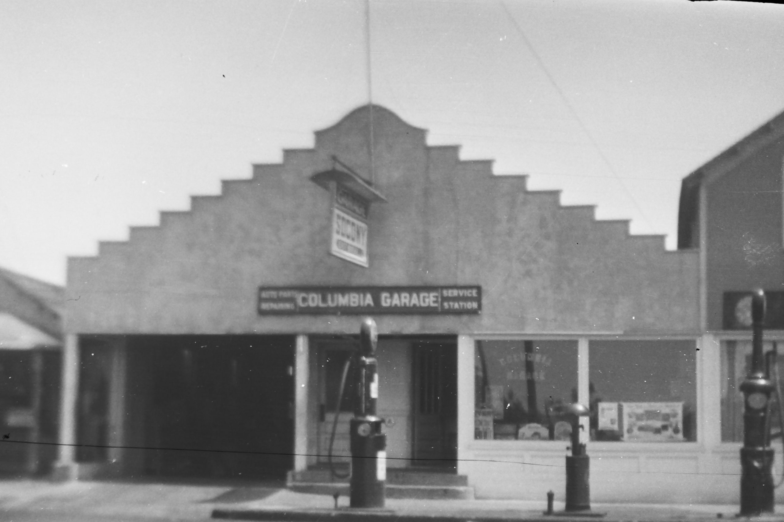 The facade of what was once Columbia Garage still exists today as Village Prime Meat Shoppe and Martin's Design & Construction Consultants.