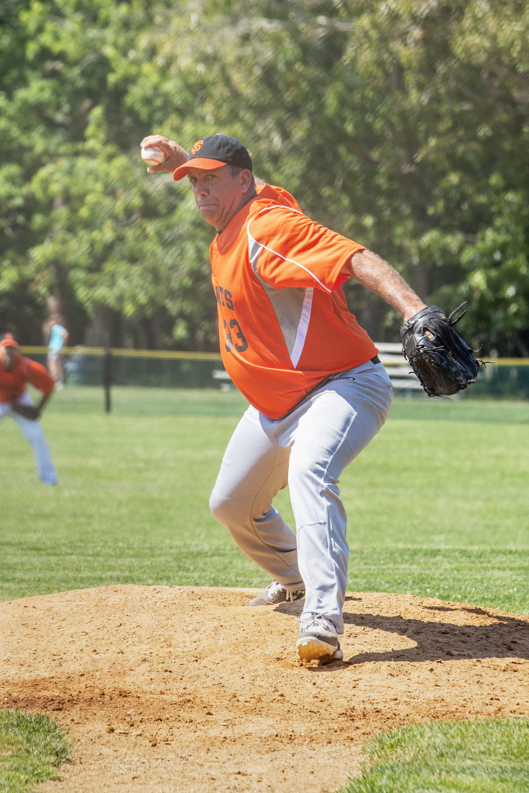 Hamptons Adult Hardball League Co-Founder Pete Barylski pitches during the league's inaugural game at Mashashimuet Park in Sag Harbor on Sunday.