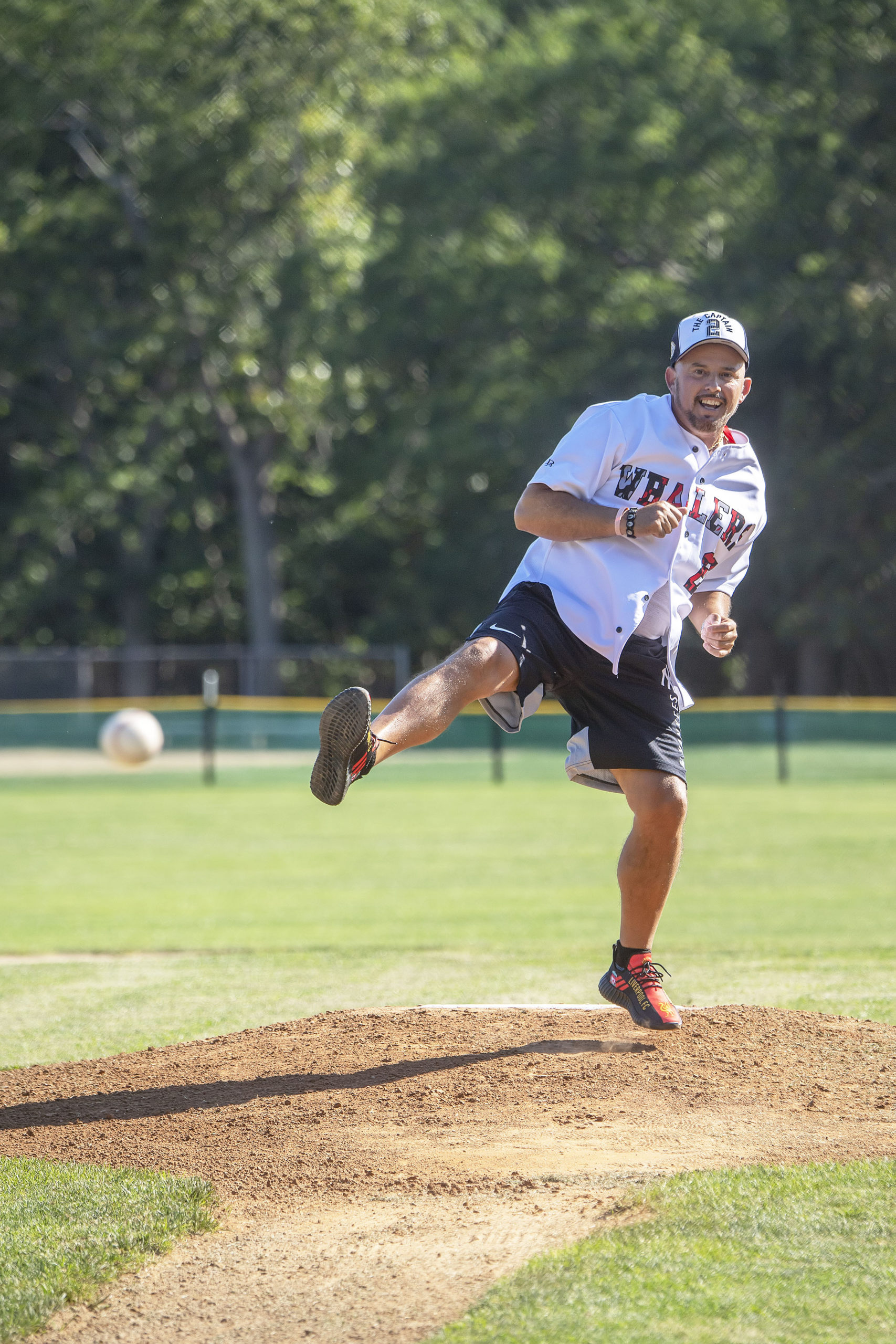 Longtime Sag Harbor Schools employee Gjon Bersiha was honored by throwing out the first pitch of the 2021 Hamptons Collegiate Baseball League season.
