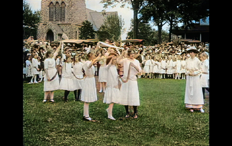 Girls dancing in a Pathé News newsreel of East Hampton's Fourth of July parade in 1915.