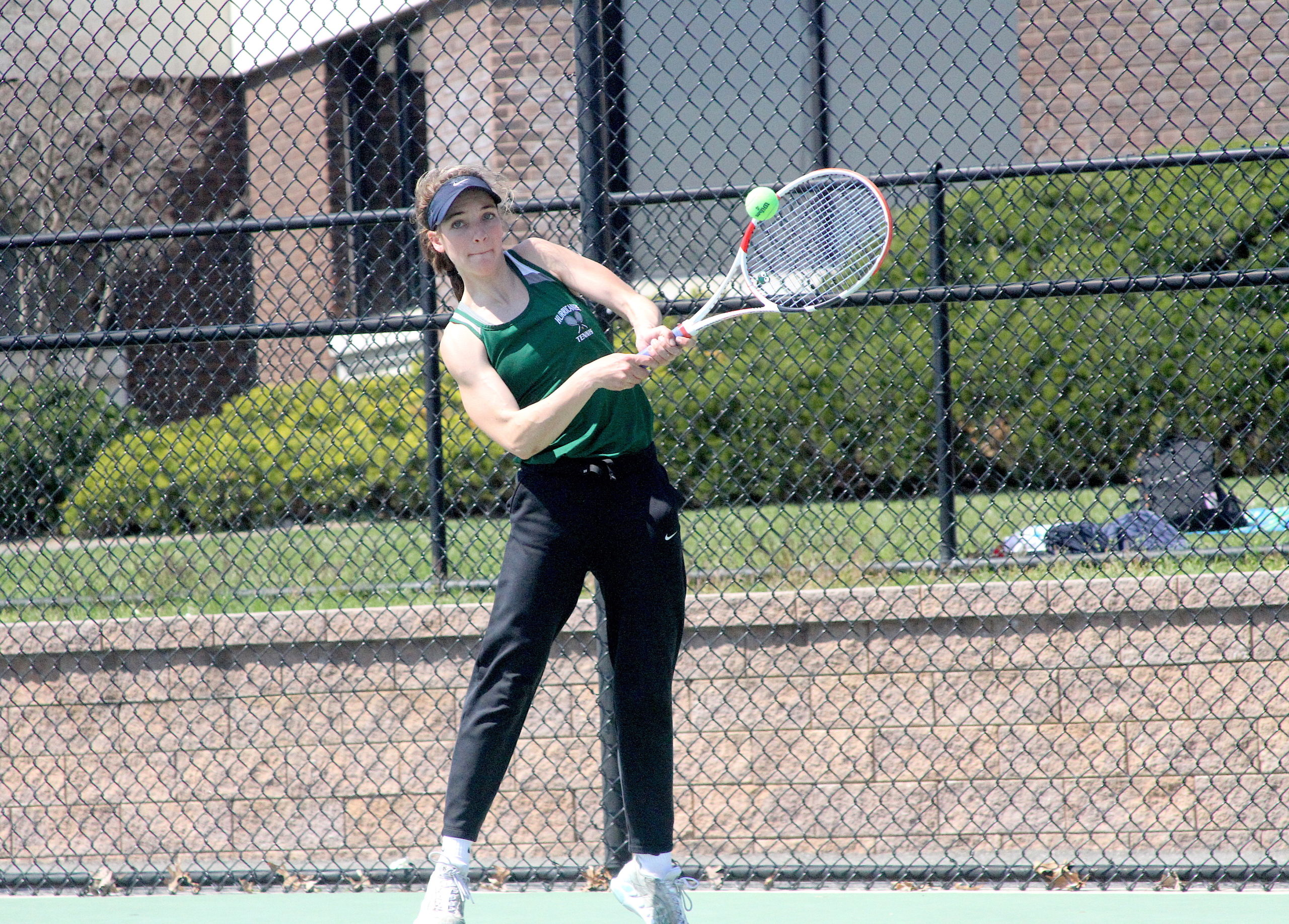 Westhampton Beach rising senior Rose Hayes connects with a serve.