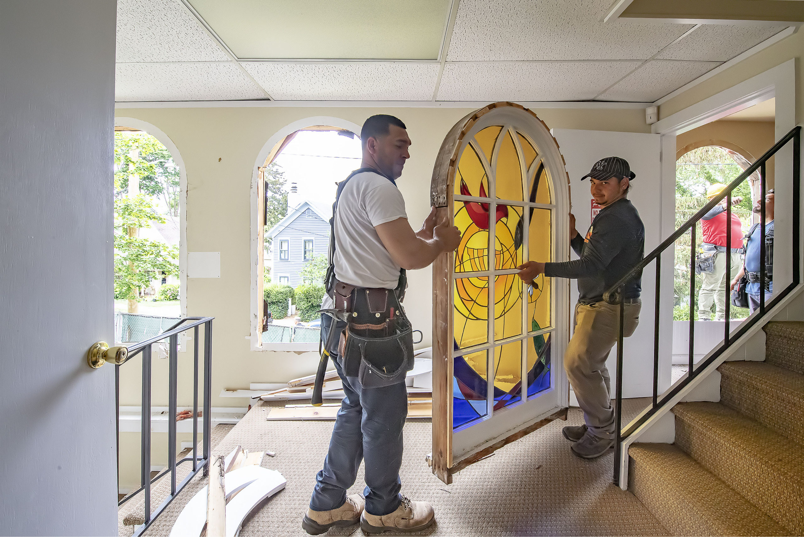Stained glass windows are removed from Temple Adas Israel in Sag Harbor on June 21 as the Temple begins an expansion and restoration of the oldest synagogue on Long Island.