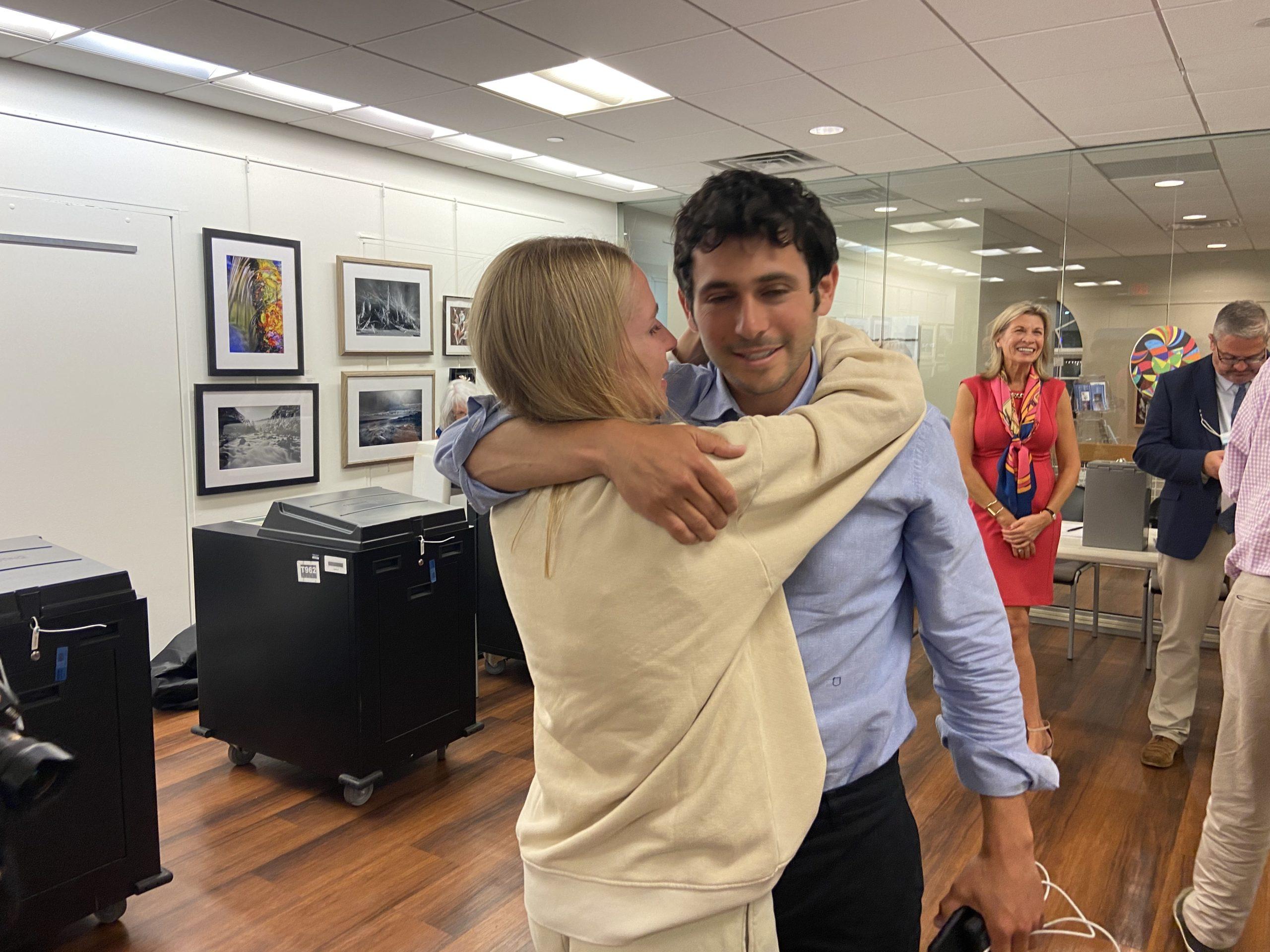 Mayor Jesse Warren gets a hug on election night. ZOE KAVA