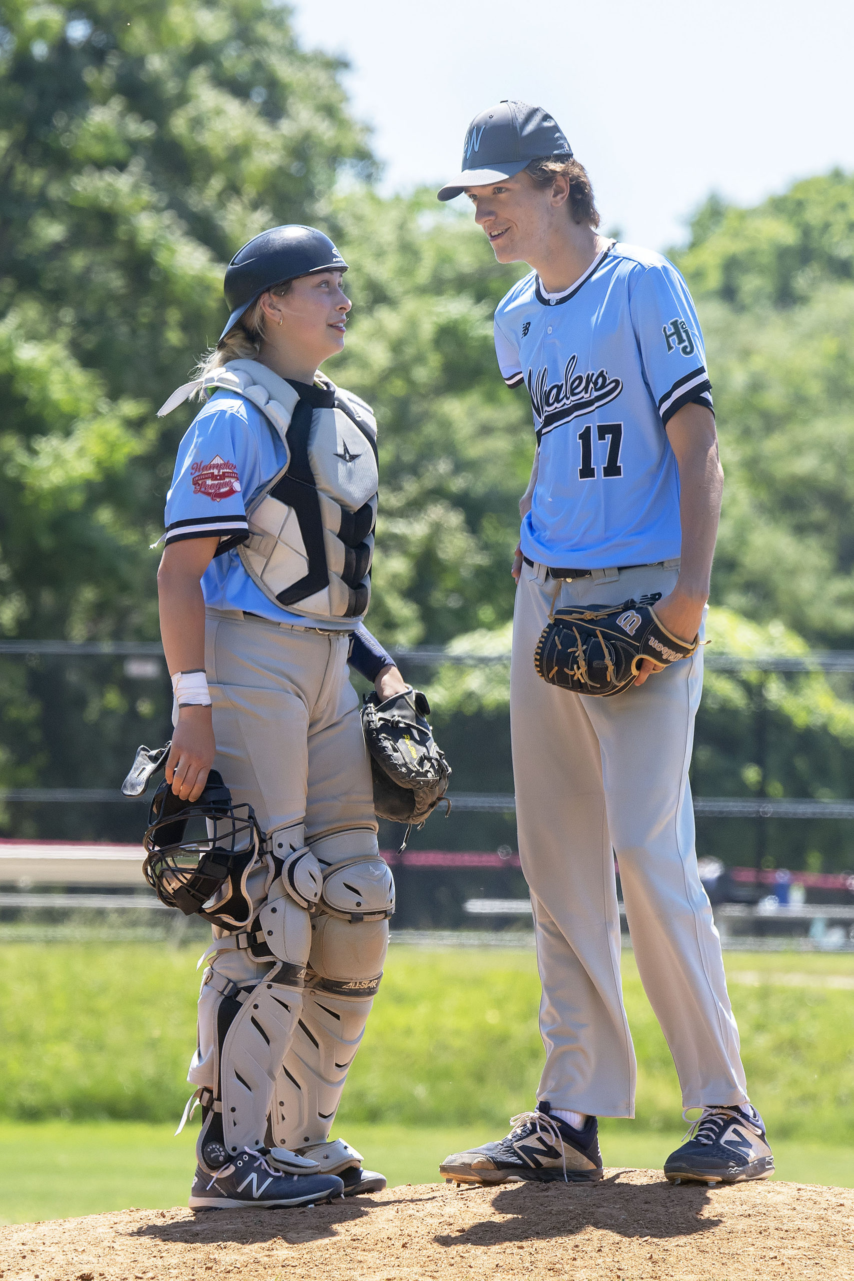 Marika Lyszczyk going over things with her pitcher Carter Delaney.