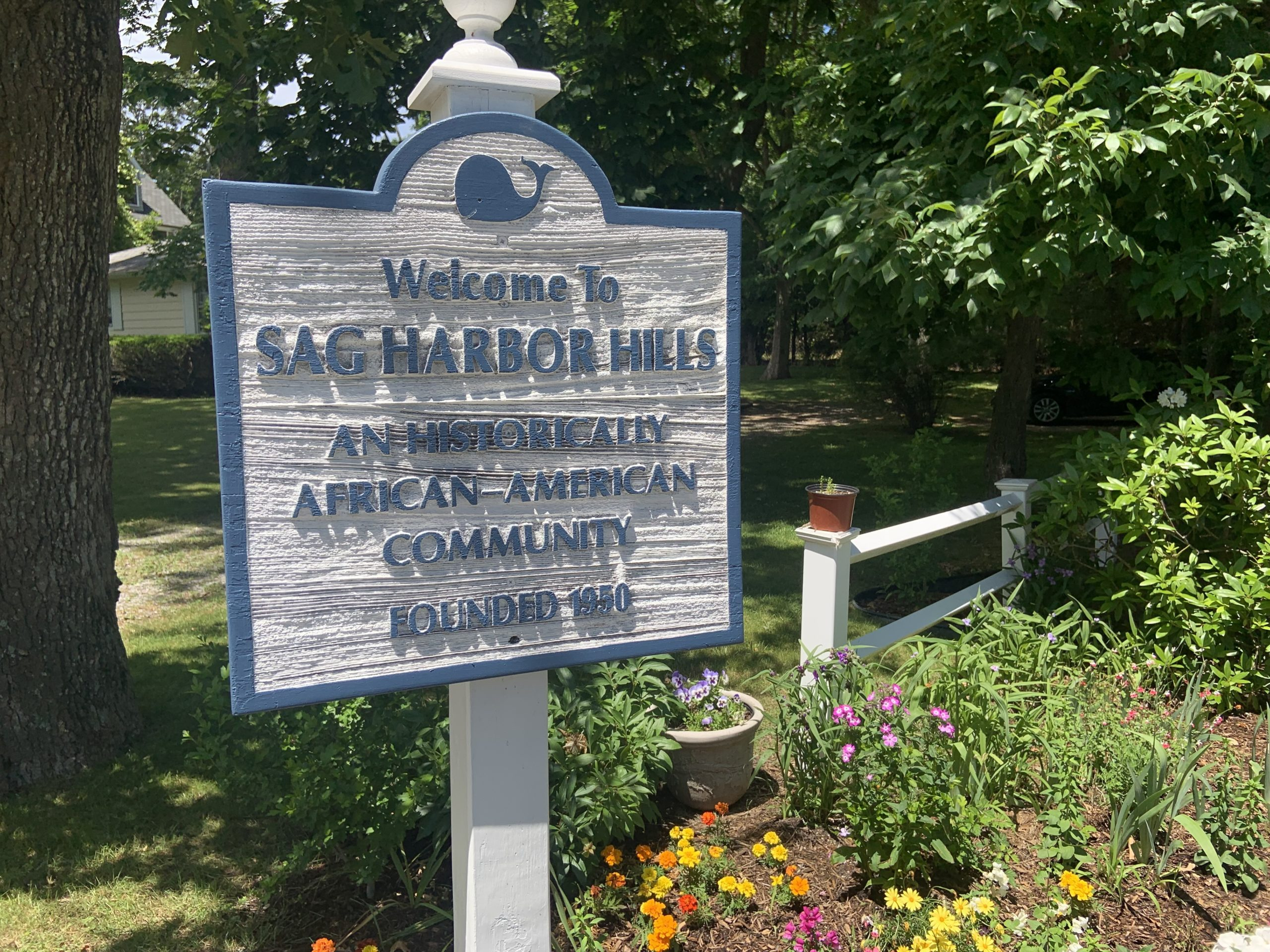 A sign at the entrance to the Sag Harbor Hills neighborhood in Sag Harbor refers to its history as an African American community. STEPHEN J. KOTZ