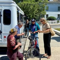Suffolk County Legislator Bridget Fleming, right, with other riders, including, from left, Elfriede Neuman, Tom Neely, and Sean Neuman,  took part in the inaugural run of the new Suffolk County On-Demand bus route. MICHAEL IASILLI