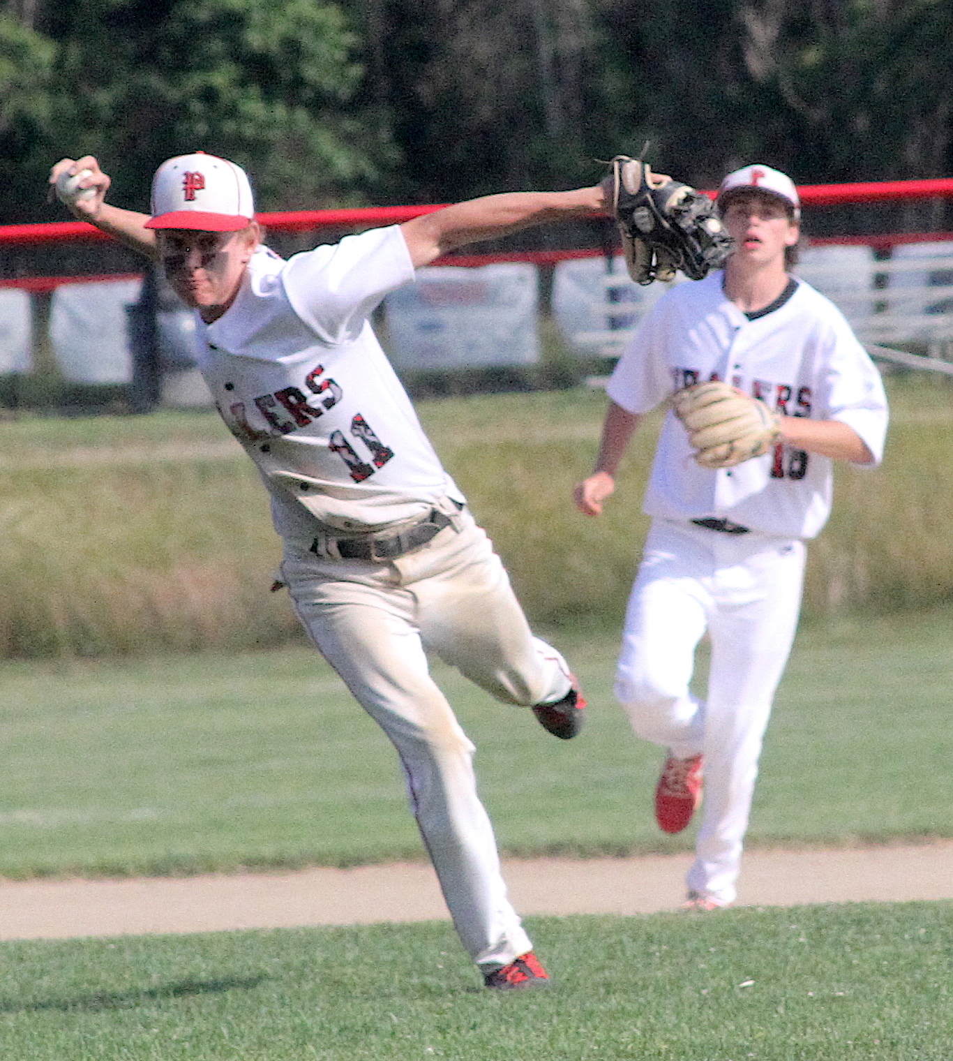 Sophomore Gavin Gilbride scoops up the ball and throws to first base. DESIRÉE KEEGAN