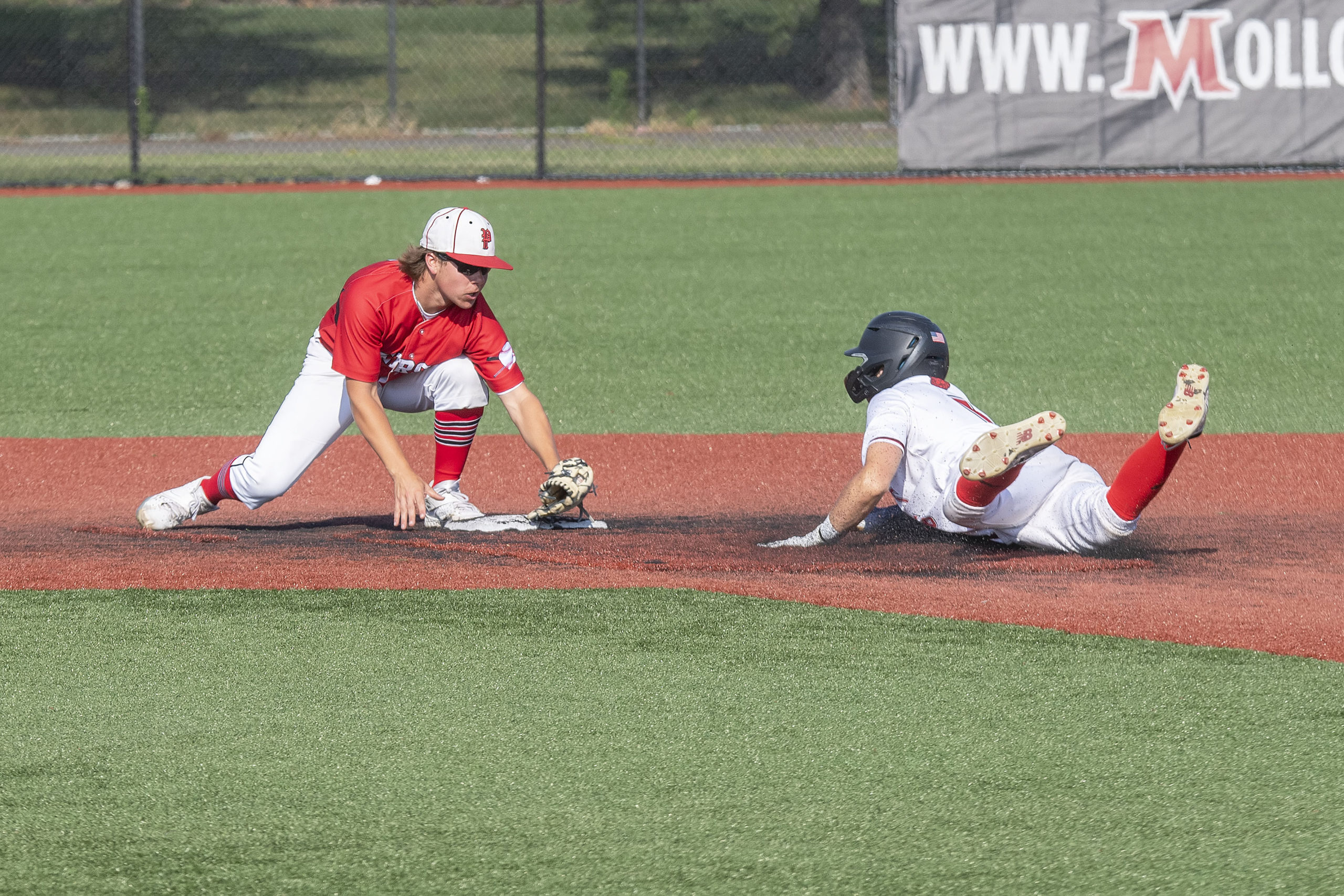 Whaler Christian Pantina thwarts an attempt to steal second base after receiving a throw from catcher Tucker Schiavoni.
