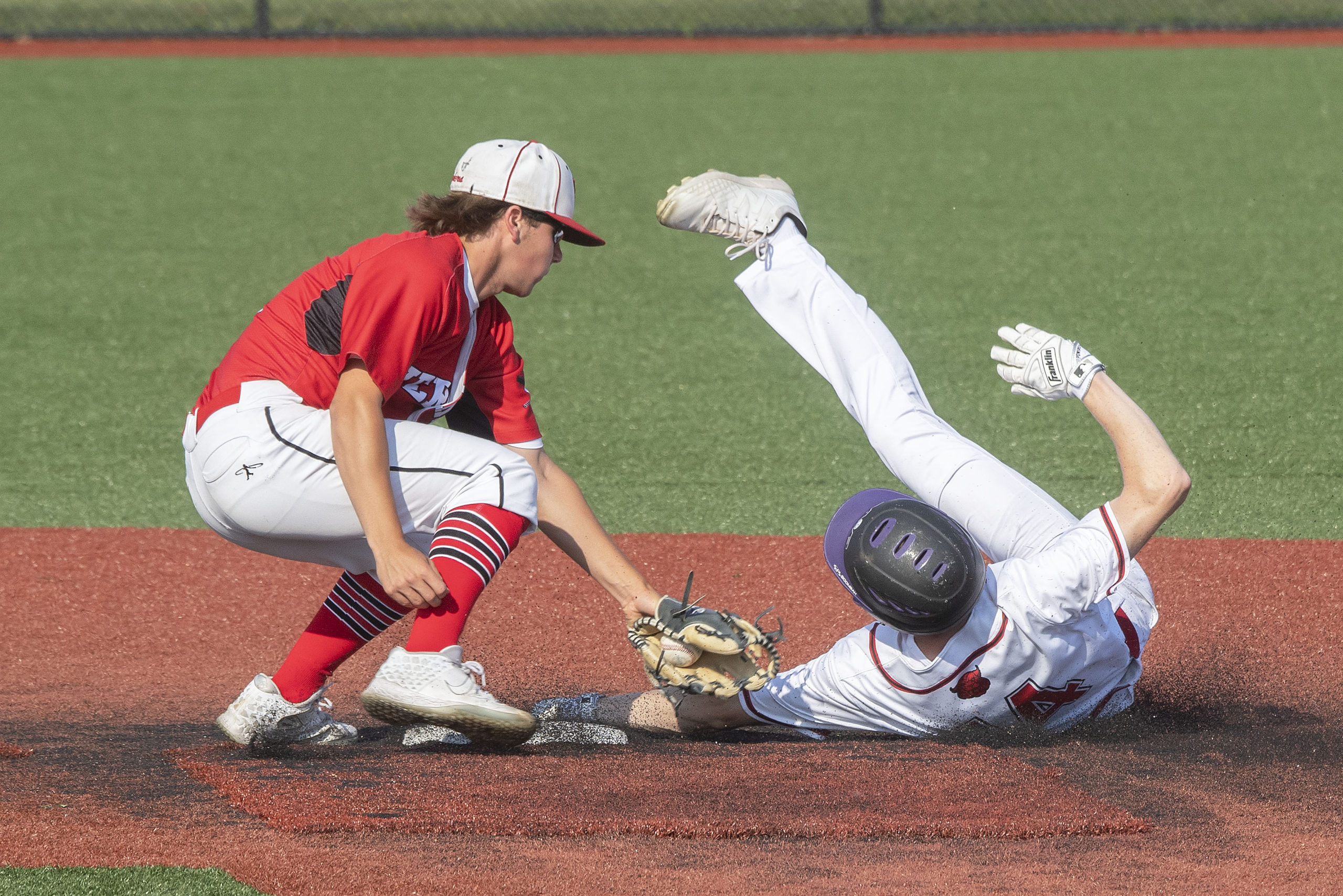 Pierson's Christian Pantina goes to tag out a runner trying to steal second base.