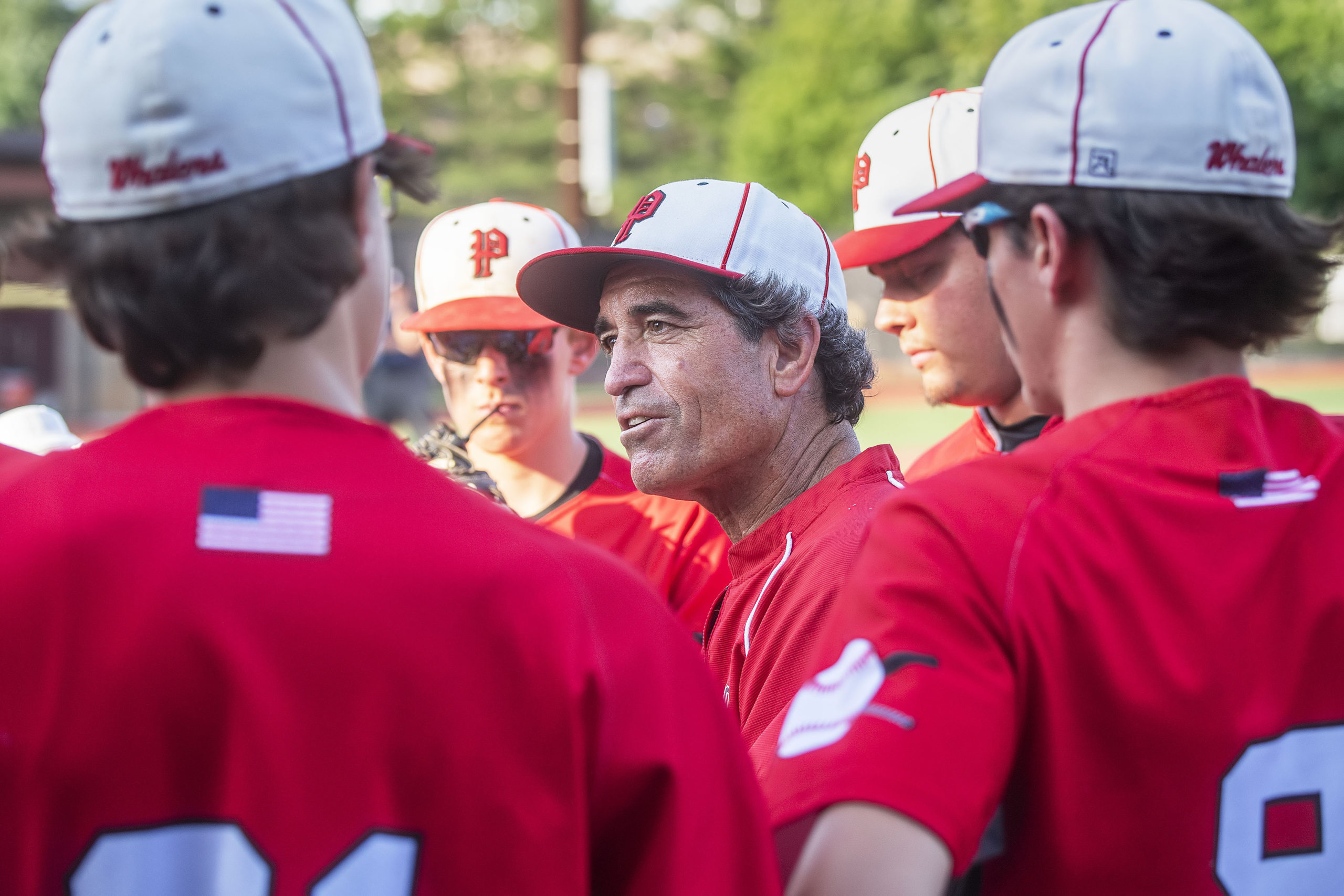 Pierson assistant coach Benito Vila gives the team a pep talk after a rough inning.
