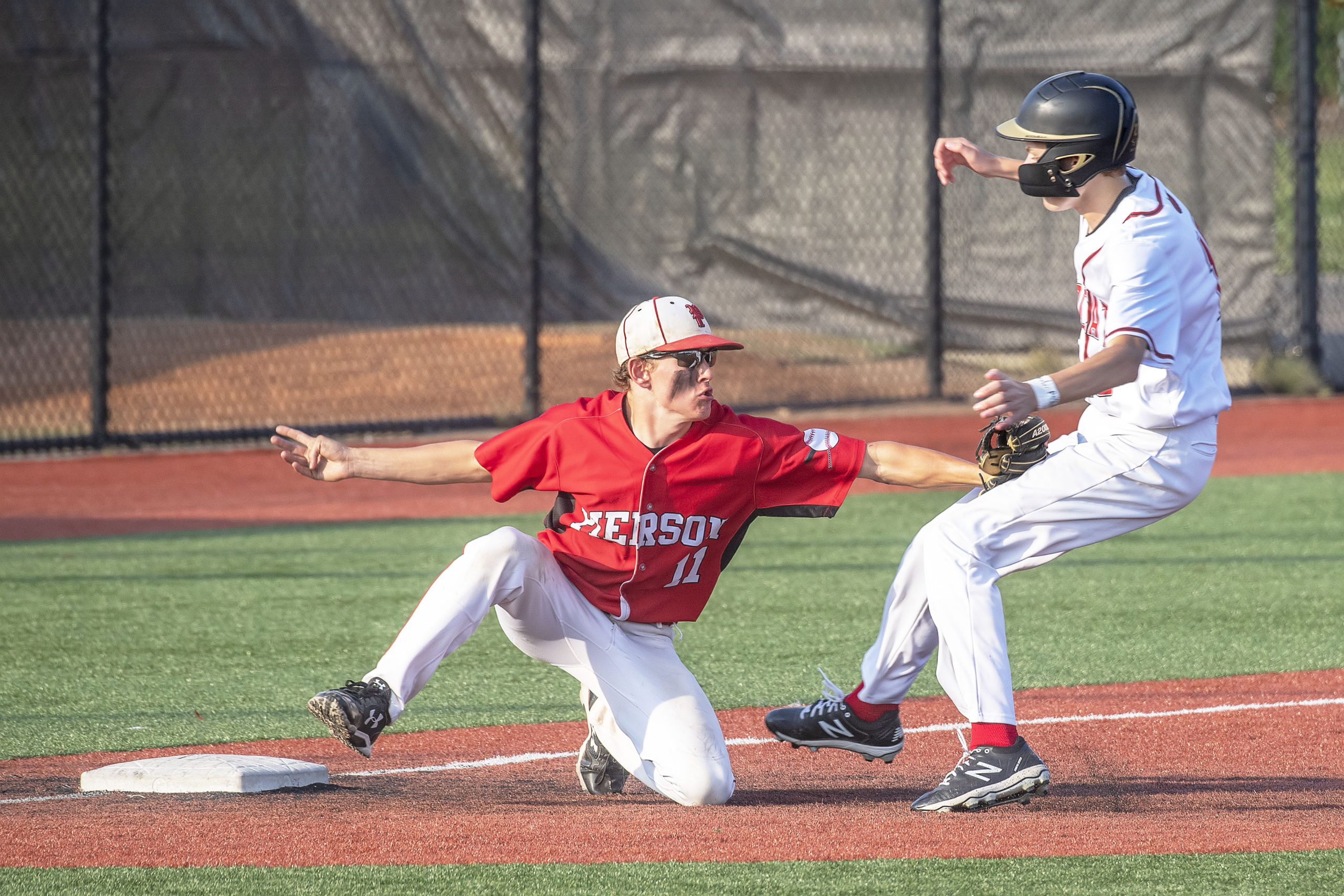Pierson's Gavin Gilbride tags a runner out at third.