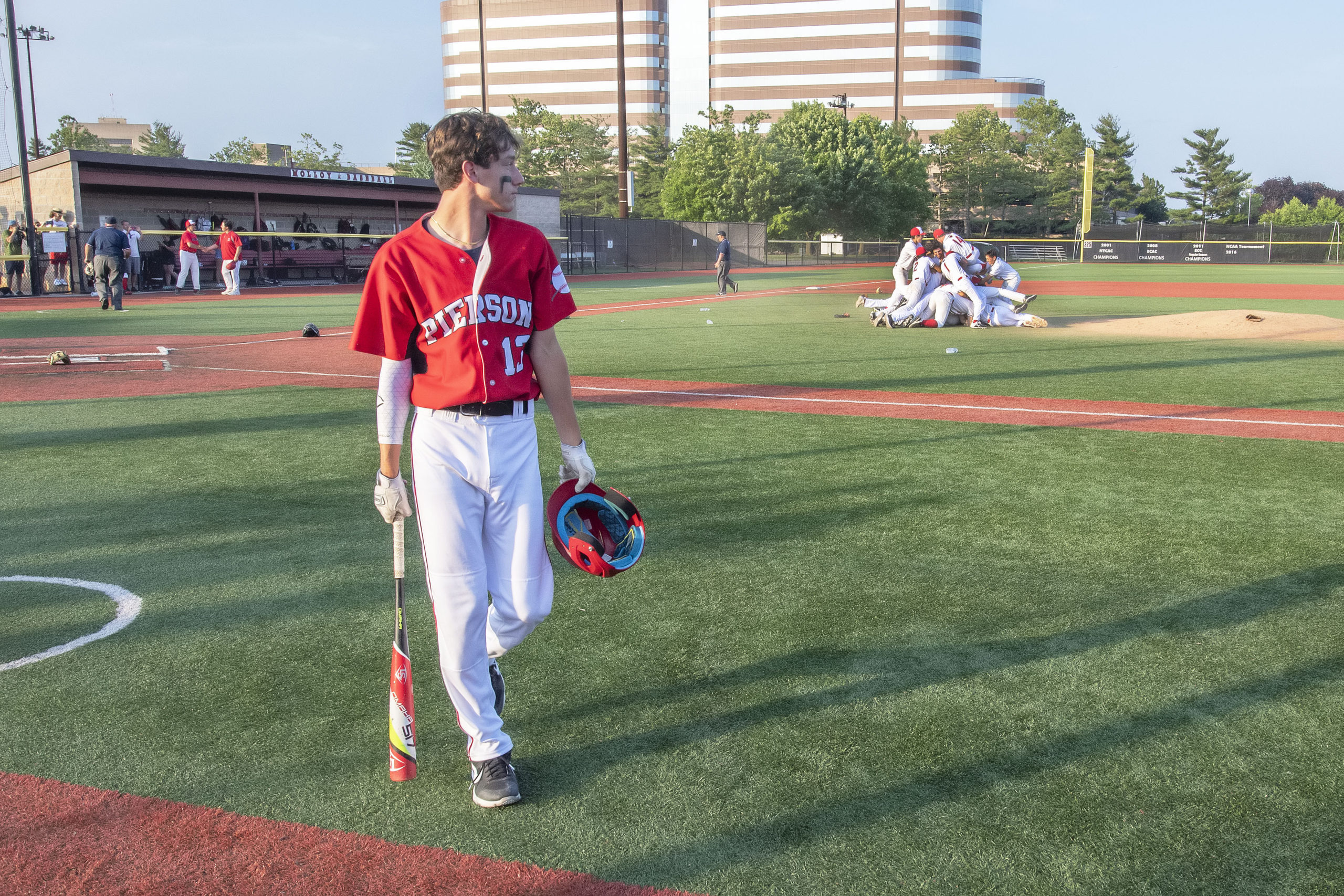 Pierson's Vincent Cavaniola watches the Wildcats celebrate their win as he walks back to the dugout.