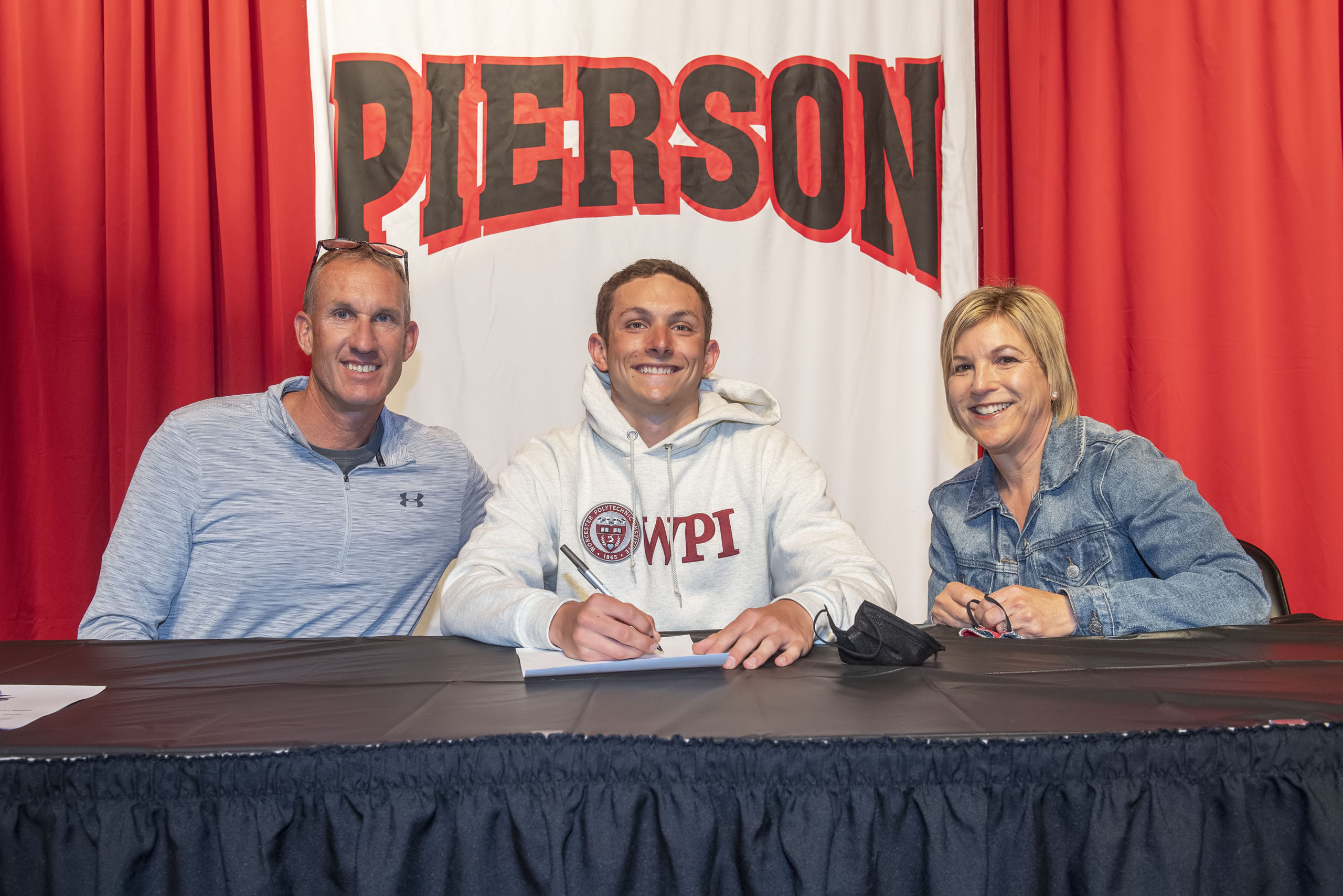 Pierson senior Jack Duryea, with his parents  Chris and Elise, signed his letter of intent to swim at Worcester Polytechnic Institute in early May.  MICHAEL HELLER