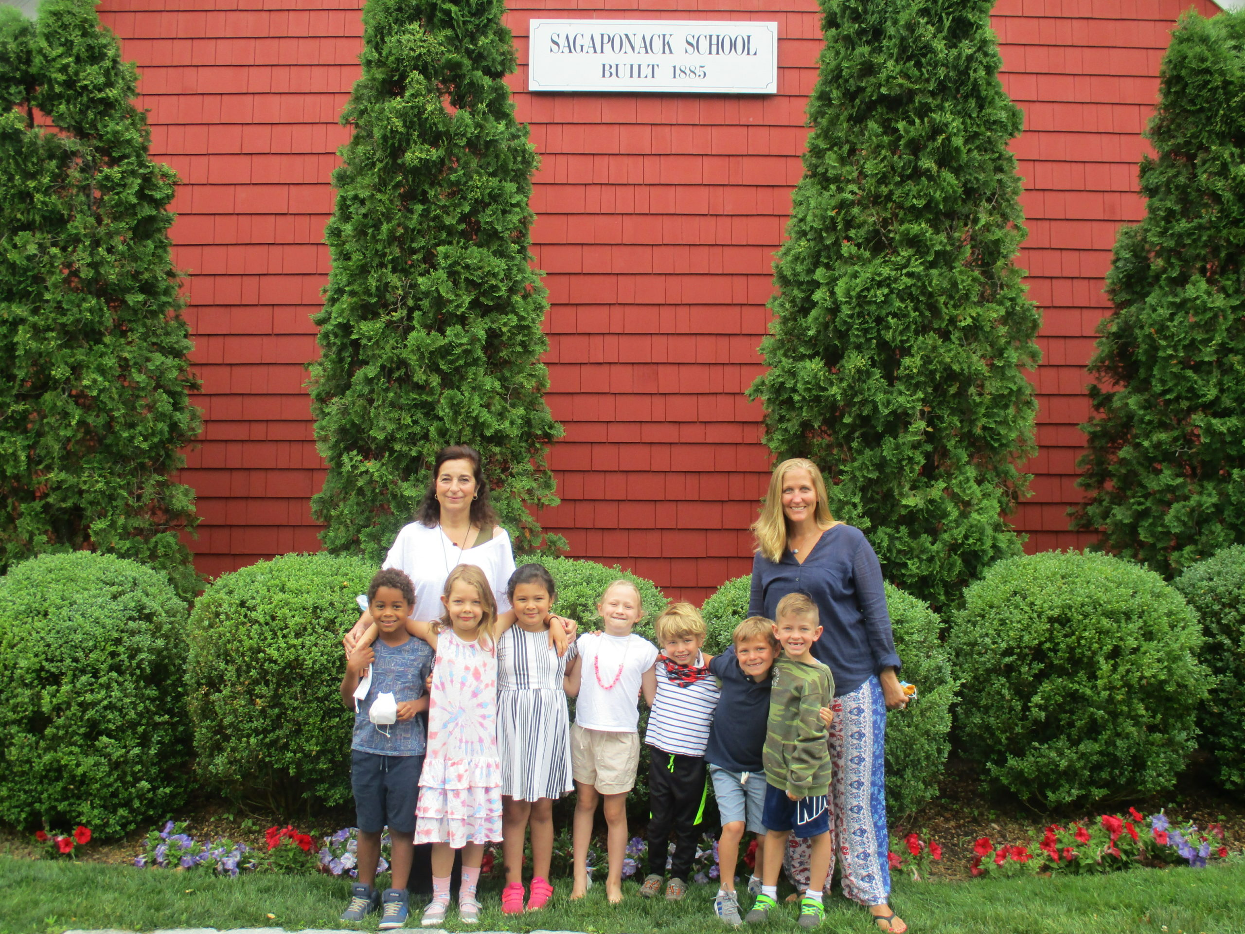 The kindergarten and first grade students at the Sagaponack School with teaching aid Mrs. Velasquez and teacher Mrs. Lombardo celebrated the last day of school with a class picture.