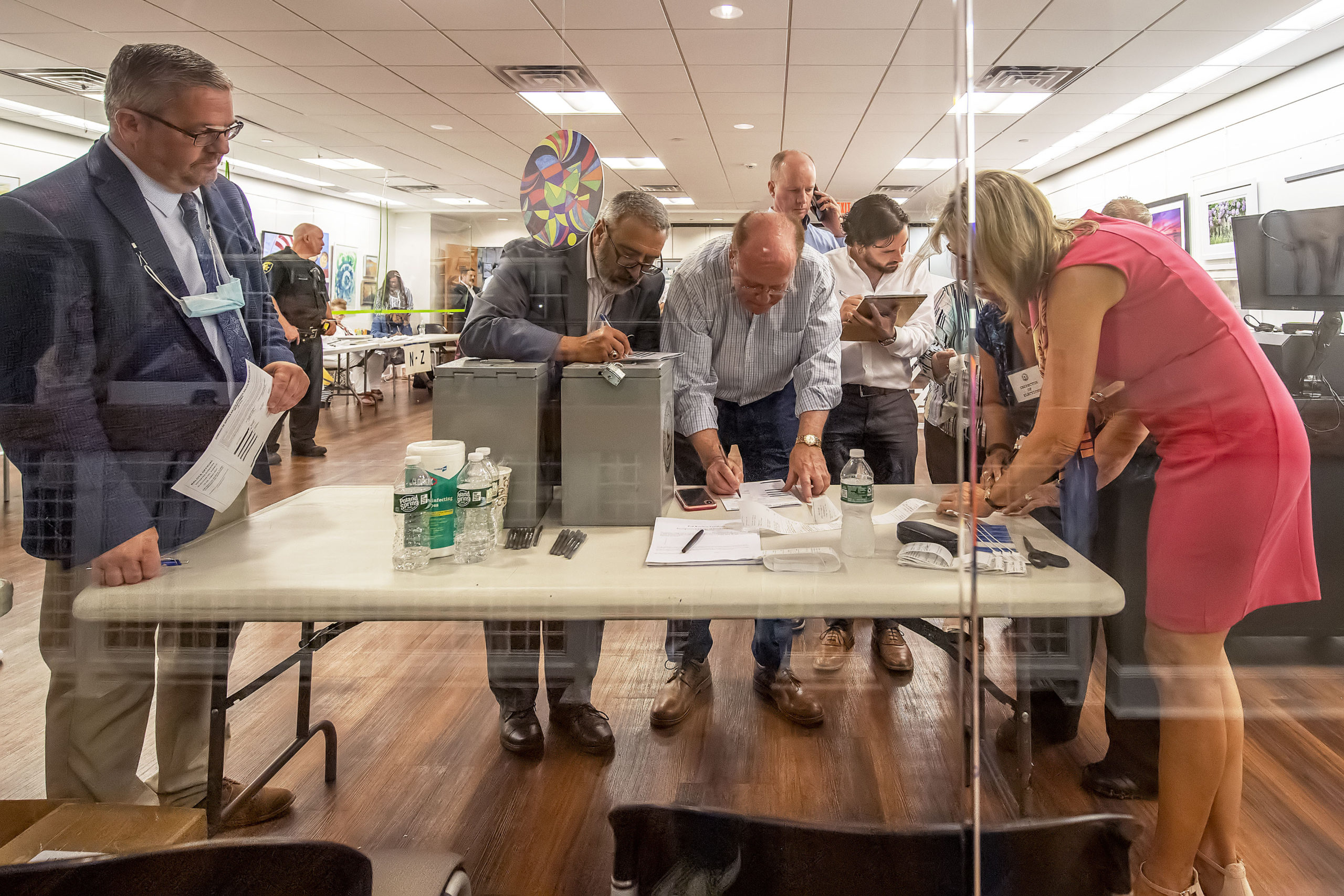 The vote count from each of the voting machines is tabulated during the 2021 Southampton Village Mayoral election at the Southampton Cultural Center on Friday night. MICHAEL HELLER