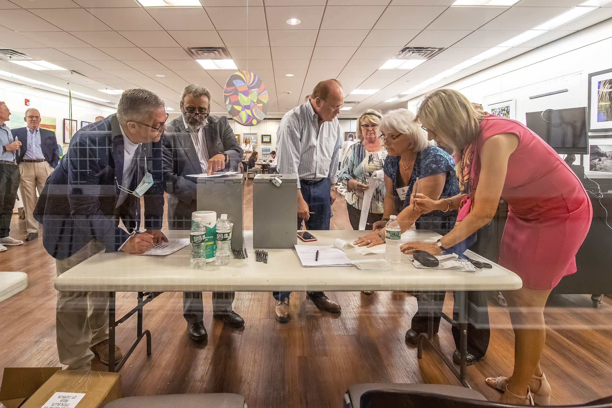The vote count from each of the voting machines is tabulated during the 2021 Southampton Village Mayoral election at the Southampton Cultural Center on Friday night. MICHALE HELLER