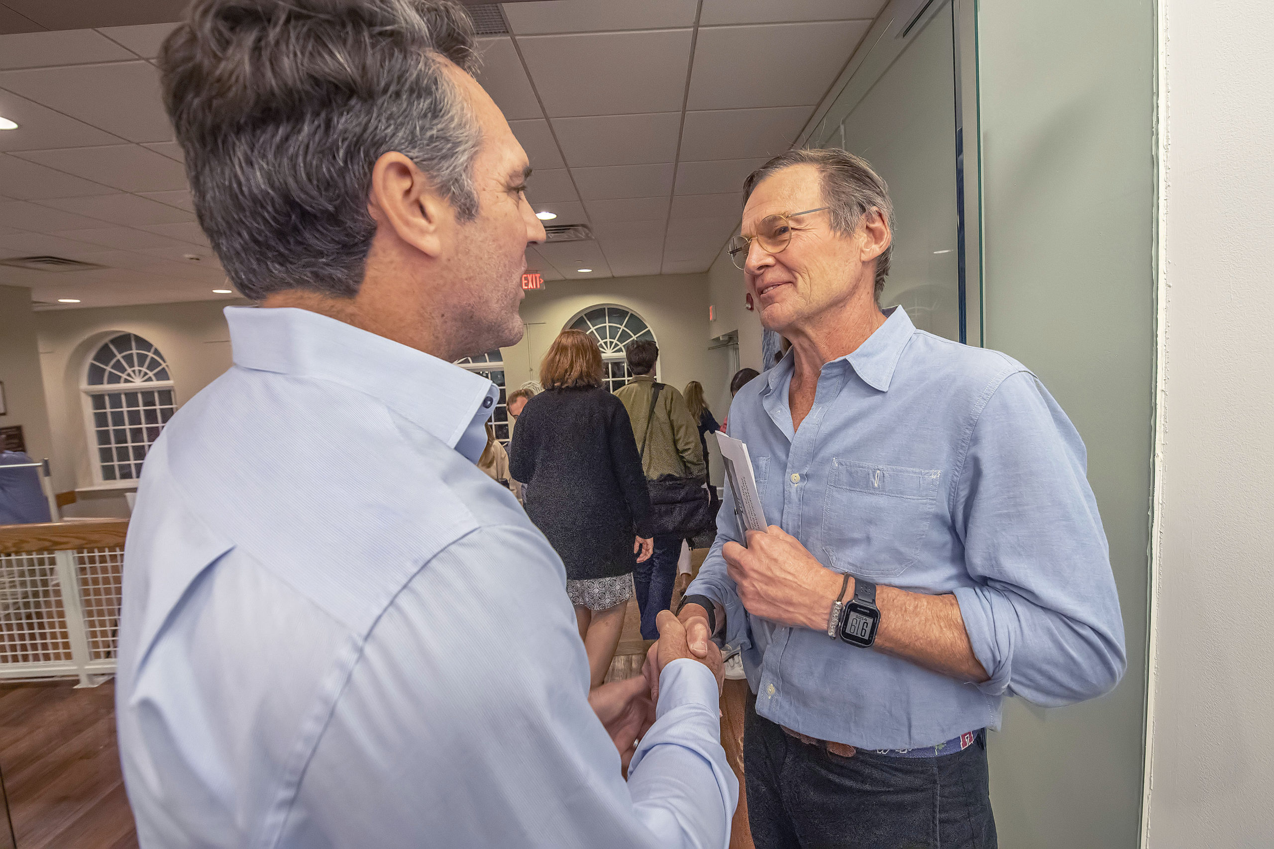 Mark Parash congratulates opponent Roy Stevenson on his victory in the race for village board following the 2021 Southampton Village Mayoral election at the Southampton Cultural Center on Friday night. MICHAEL HELLER
