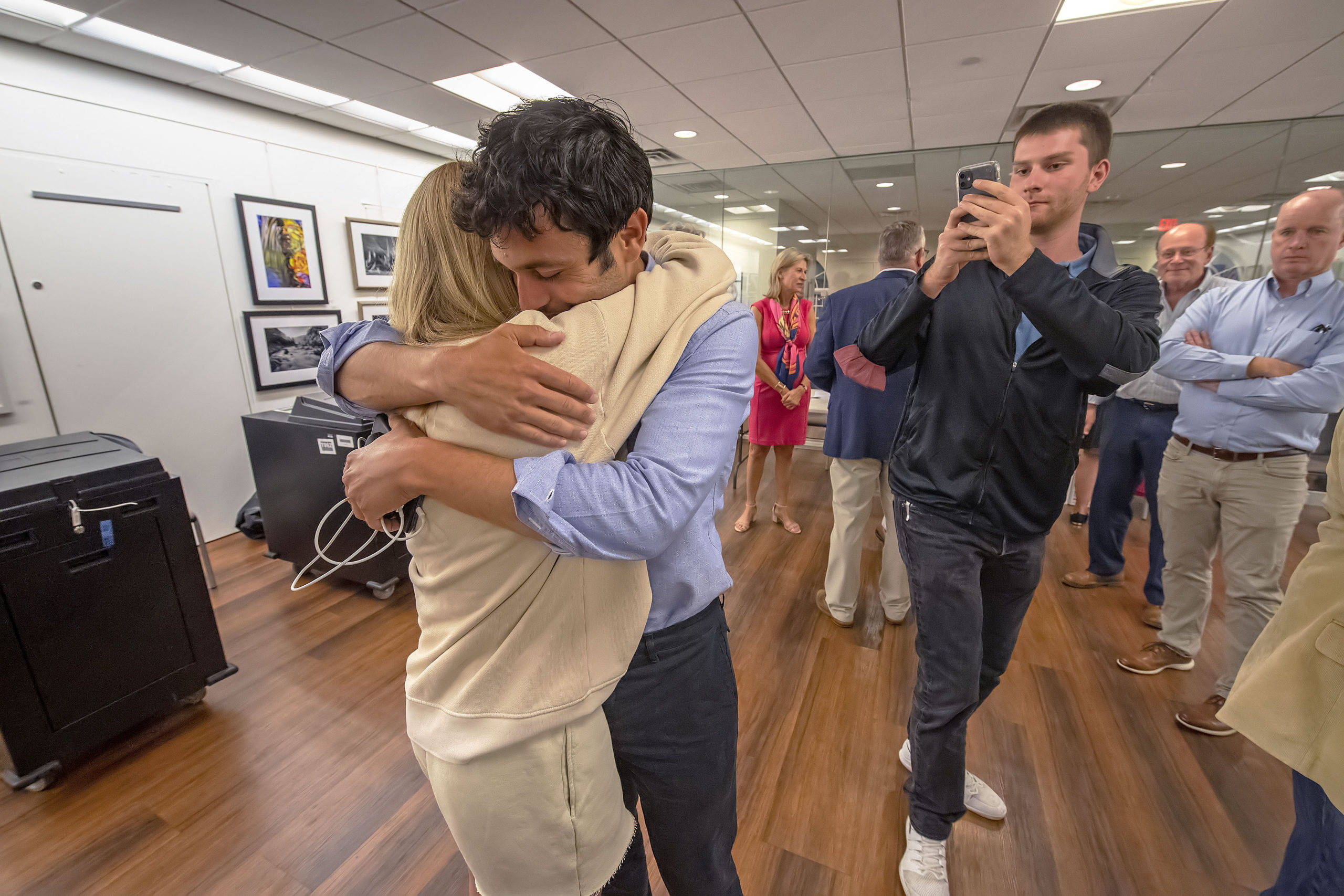 As his communications director takes some video, newly-re-elected Southampton Village Mayor Jesse Warren gets a long hug from his girlfriend Martyna Sokol following the 2021 Southampton Village Mayoral election at the Southampton Cultural Center on Friday night. MICHAEL HELLER