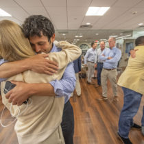 Newly-re-elected Southampton Village Mayor Jesse Warren gets a long congratulatory hug from his girlfriend Martyna Sokol following the 2021 Southampton Village Mayoral election at the Southampton Cultural Center on Friday night. MICHAEL HELLER