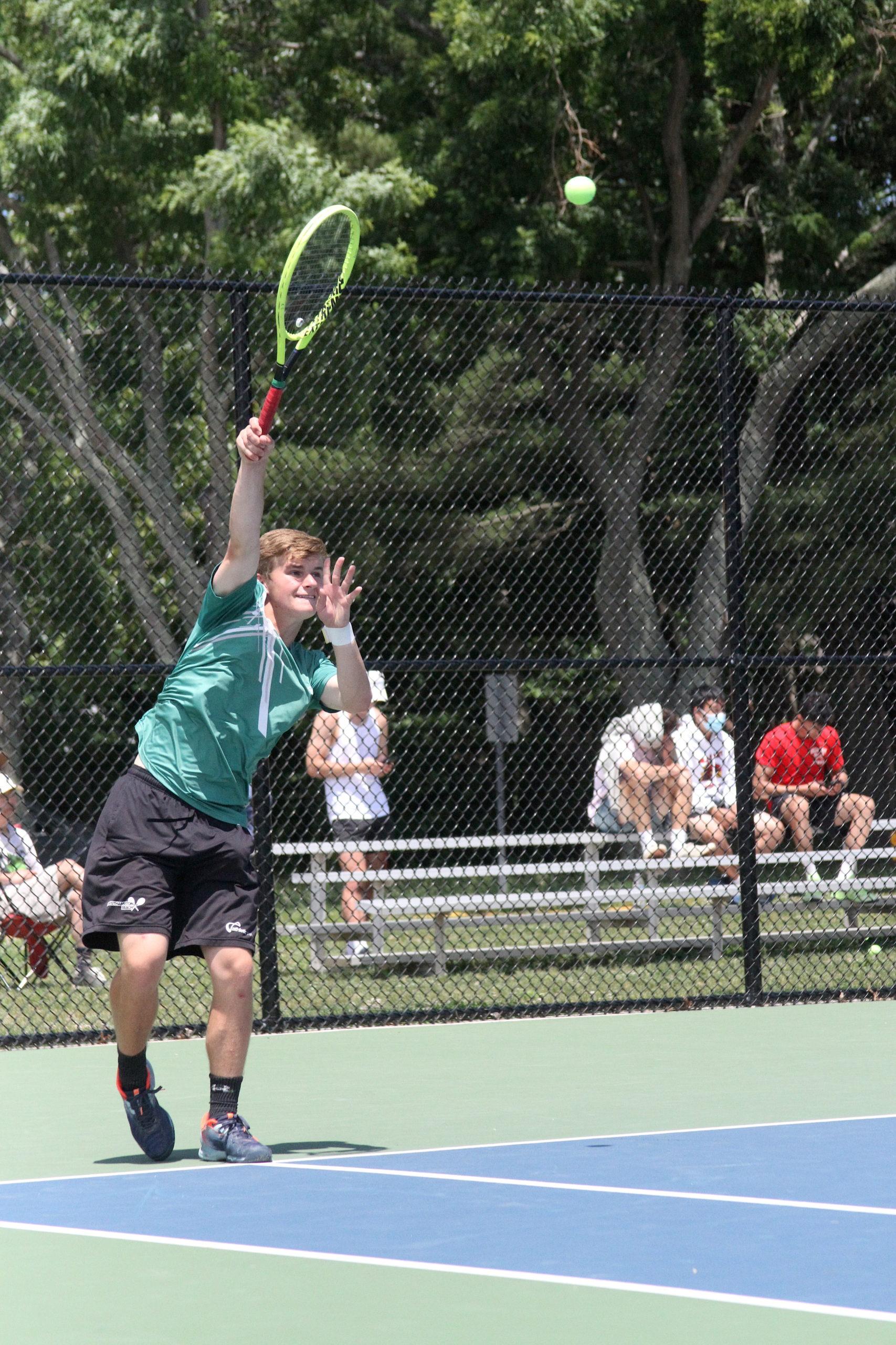Westhampton Beach sophomore Bobby Stabile serves in his No. 3-seeded doubles team's DESIRÉE KEEGAN