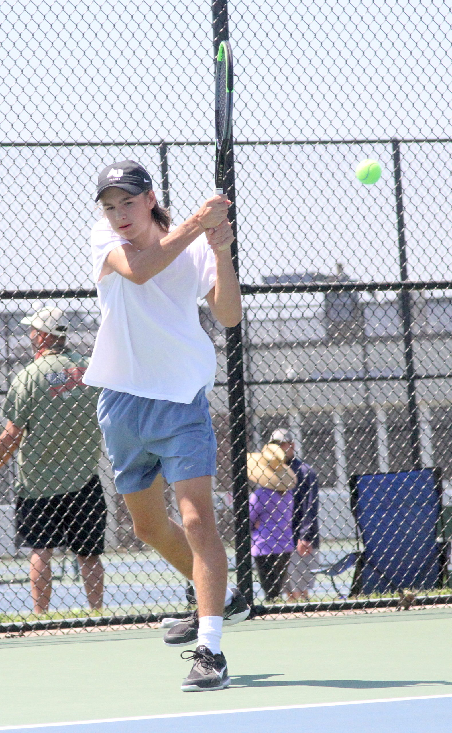 East Hampton sophomore Max Astilean sends the ball back over the net in his Division IV quarterfinals match. DESIRÉE KEEGAN