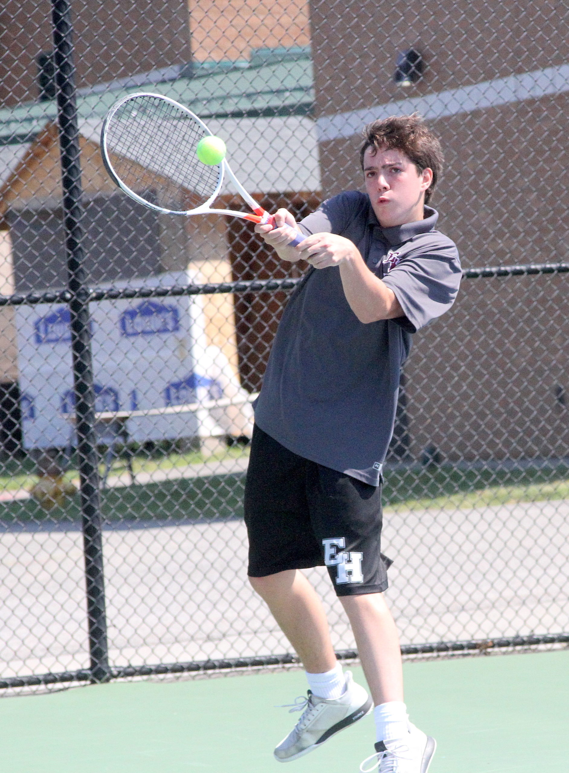 East Hampton freshman Nick Cooper connects with the ball during his Division IV quarterfinals match. DESIRÉE KEEGAN