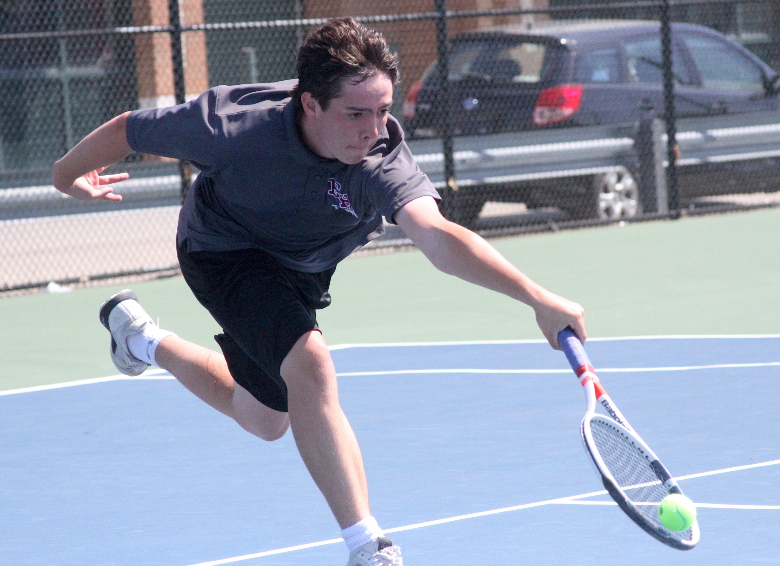 East Hampton freshman Nick Cooper races to return the ball in his Division IV quarterfinals match. DESIRÉE KEEGAN