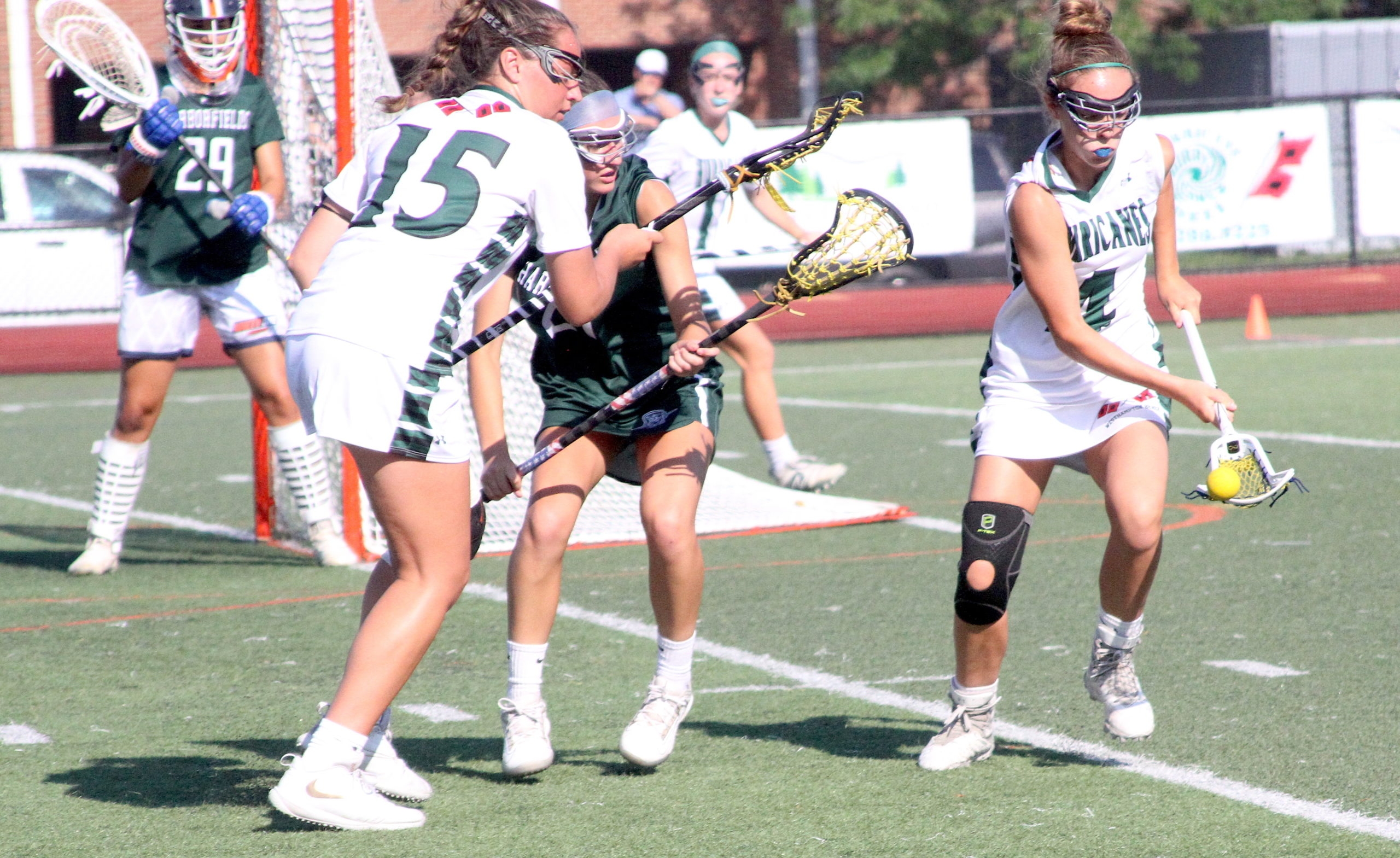 Westhampton Beach seventh-grader Ava Derby scoops up a ground ball to regain possession for the Hurricanes. DESIRÉE KEEGAN