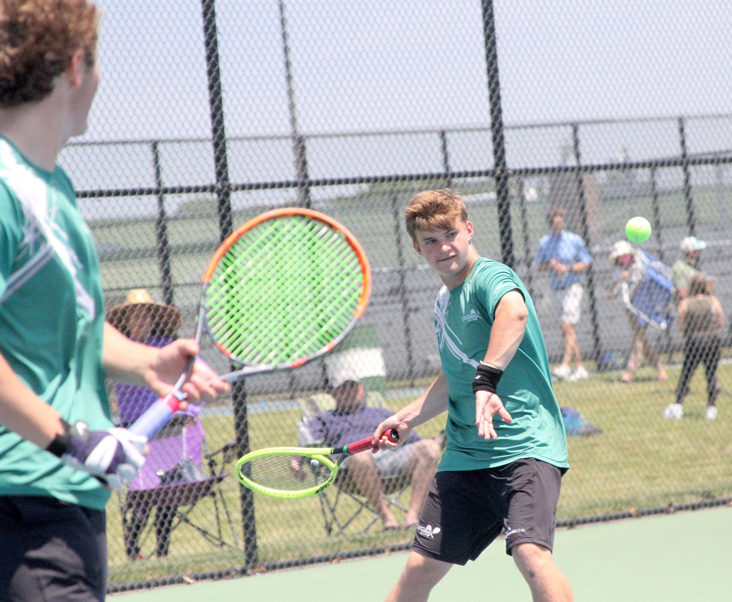 Westhampton Beach sophomore Bobby Stabile returns a serve during his doubles team's Division IV finals match. DESIRÉE KEEGAN