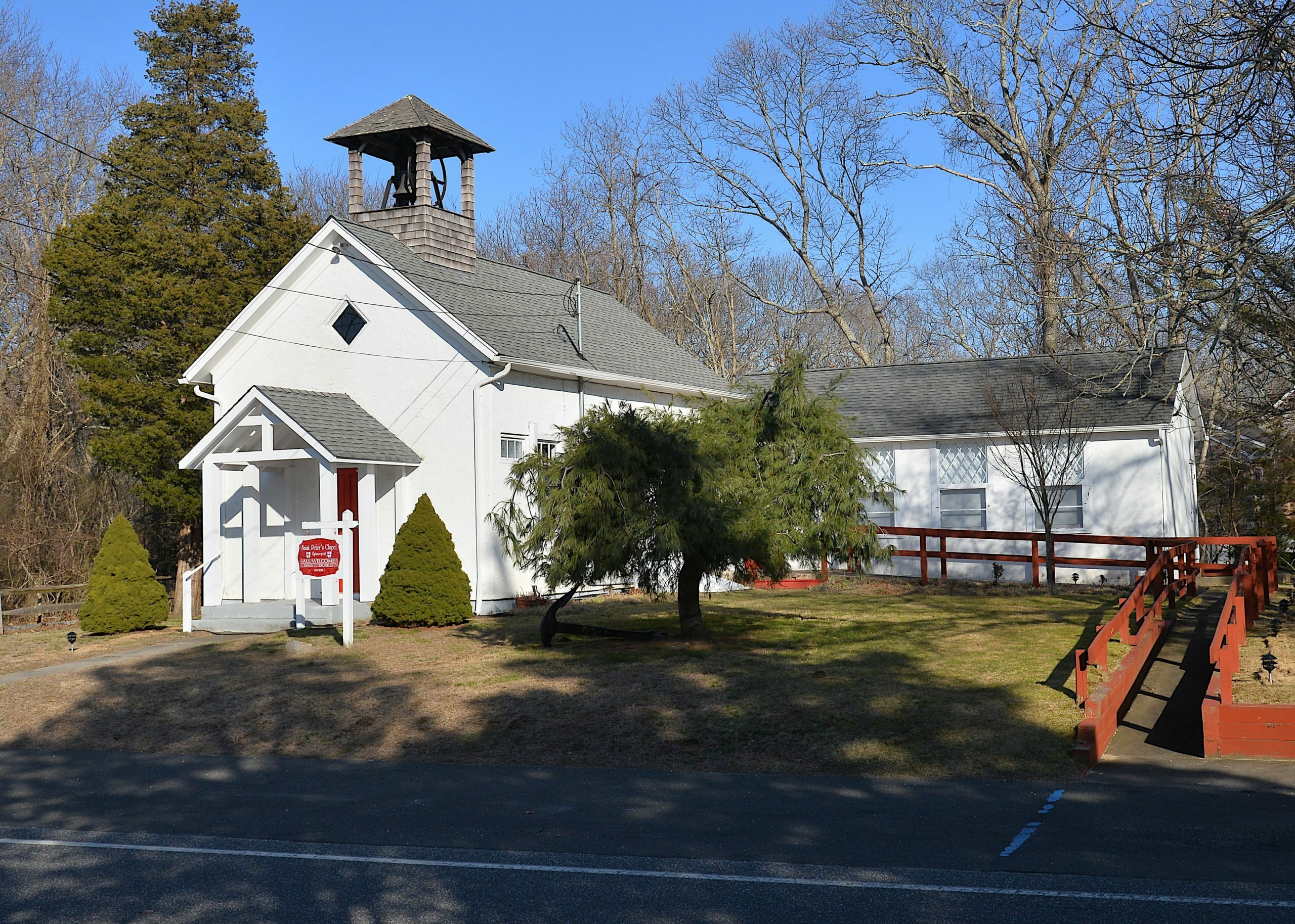 AT&T has filed a lawsuit against East Hampton Town for denying the company permission to build a 50-foot bell tower behind the St. Peter's Chapel in Springs.