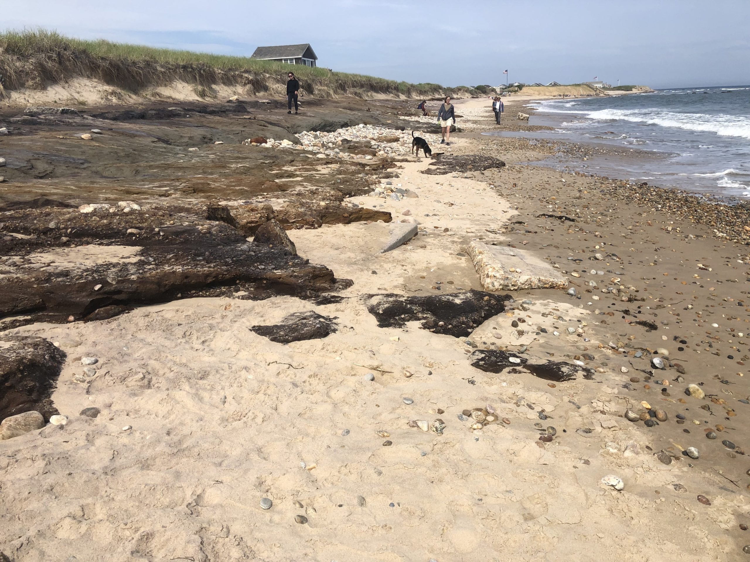 Ditch Plains beach in Montauk was scoured of nearly all of its sand by the Memorial Day weekend storm, leaving town officials to consider trucking in tons of sand to try and restore at least some of the bathing beach before the height of the summer season.