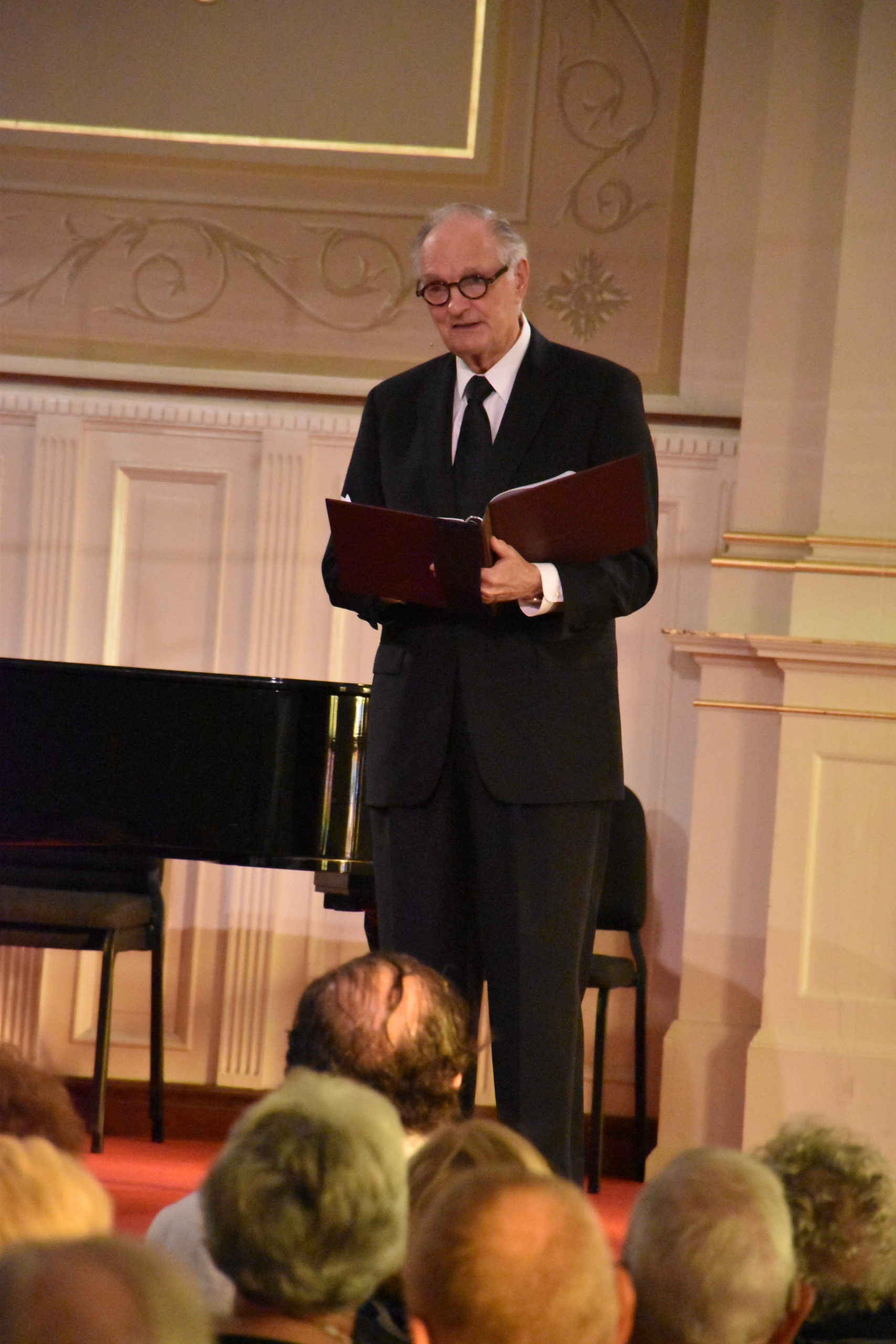 Alan Alda speaking from the stage at a previous BCMF concert.