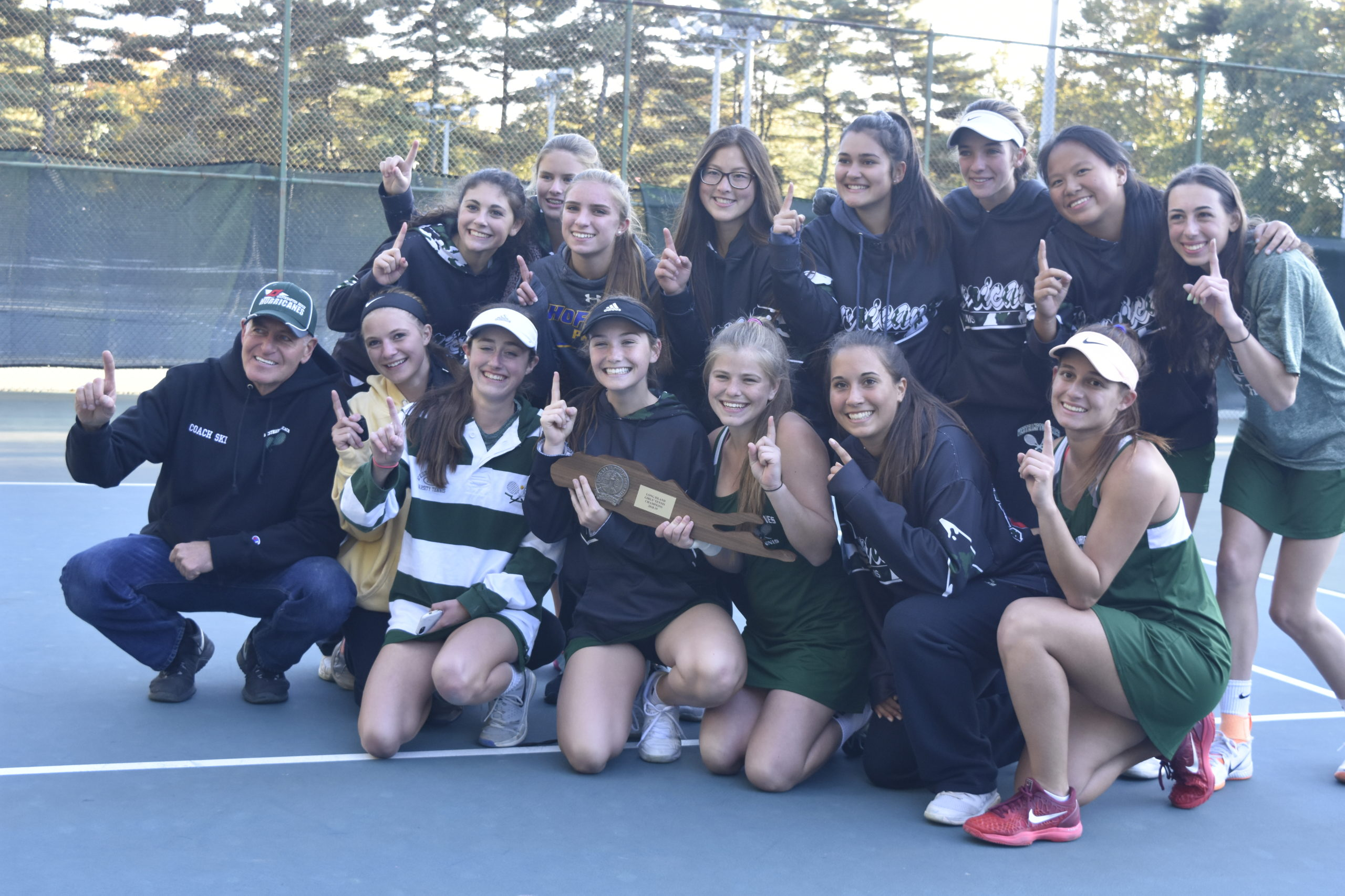 John Czartosieski, far left, led the Westhampton Beach girls tennis team to a Long Island Championship in 2018, the first team in Suffolk County to ever to do so.